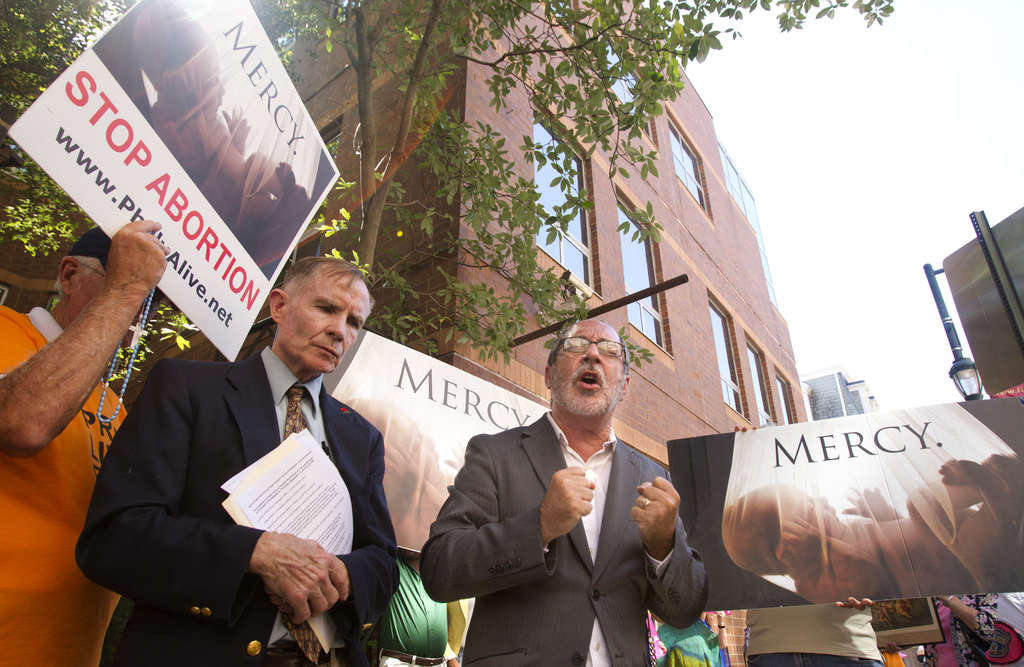 CHARLES FOX / STAFF PHOTOGRAPHER Mike McMonagle (left), the Rev. Patrick Mahoney and other members of the anti-abortion group Philly Alive pray outside Planned Parenthood at 12th and Locust streets Thursday.