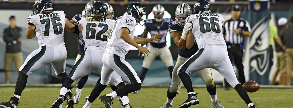 CLEM MURRAY /STAFF PHOTOGRAPHER Snap from Jason Kelce bounces away from Sam Bradford, one of the quarterback´s three turnovers against Dallas.