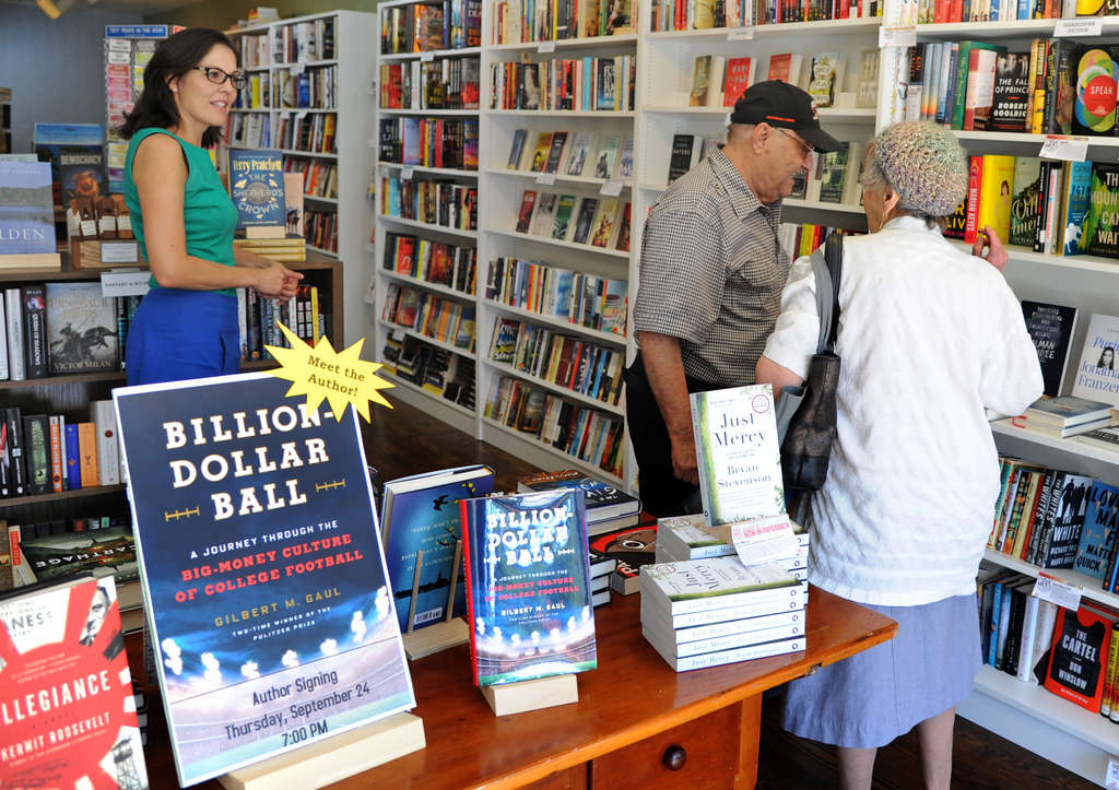 Julie Beddingfield (left) talks with customers Sam and Teresa Semola at Inkwood Books in Haddonfield, which will host authors and children´s events.
