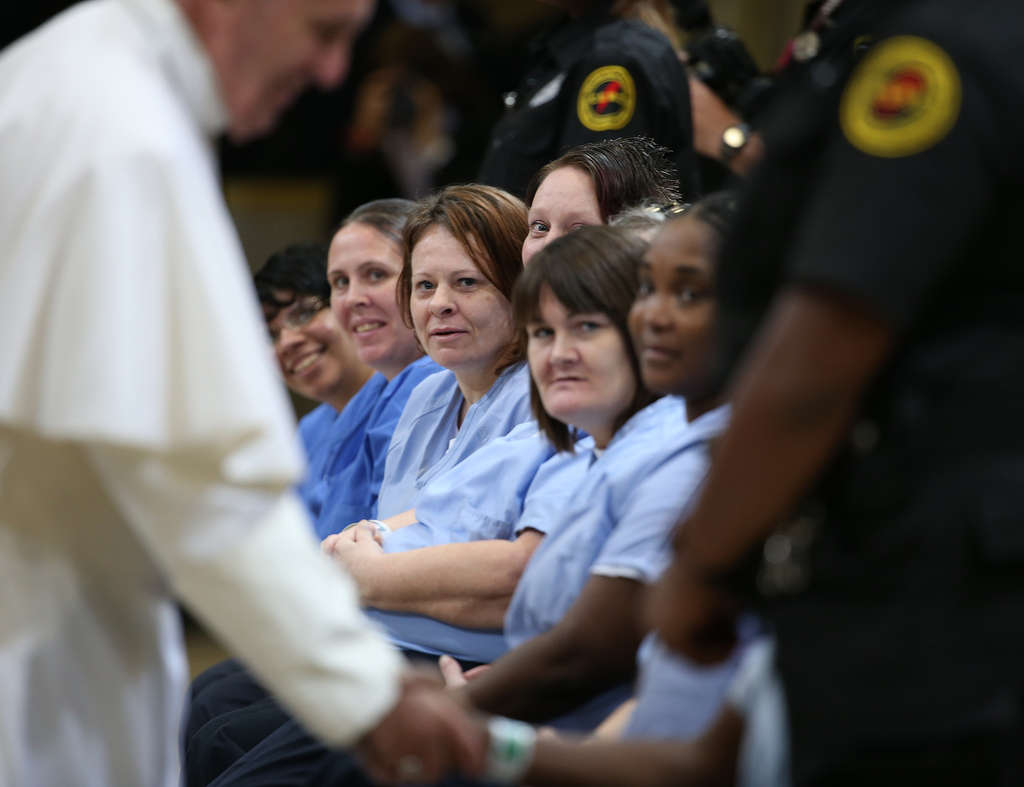 DAVID MAIALETTI / STAFF PHOTOGRAPHER Pope Francis greets female prisoners at Curran-Fromhold Correctional Facility yesterday.