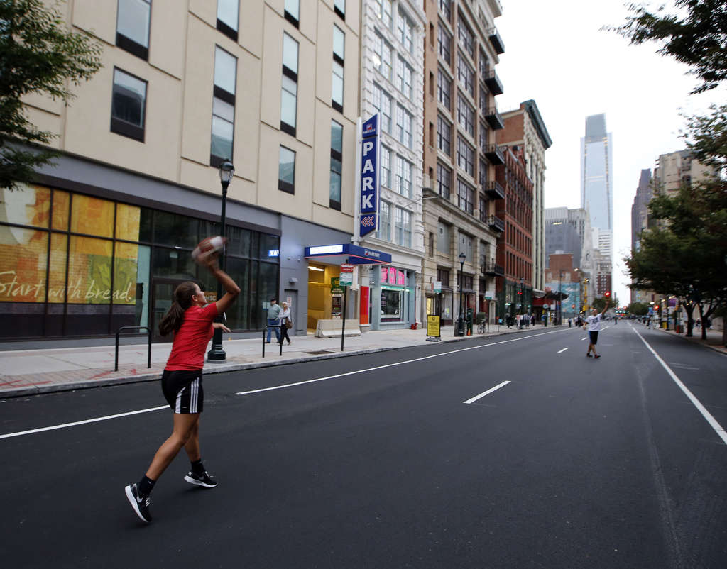 With no motor vehicles in sight, the 1200 block of Arch Street was wide open for football over the weekend.