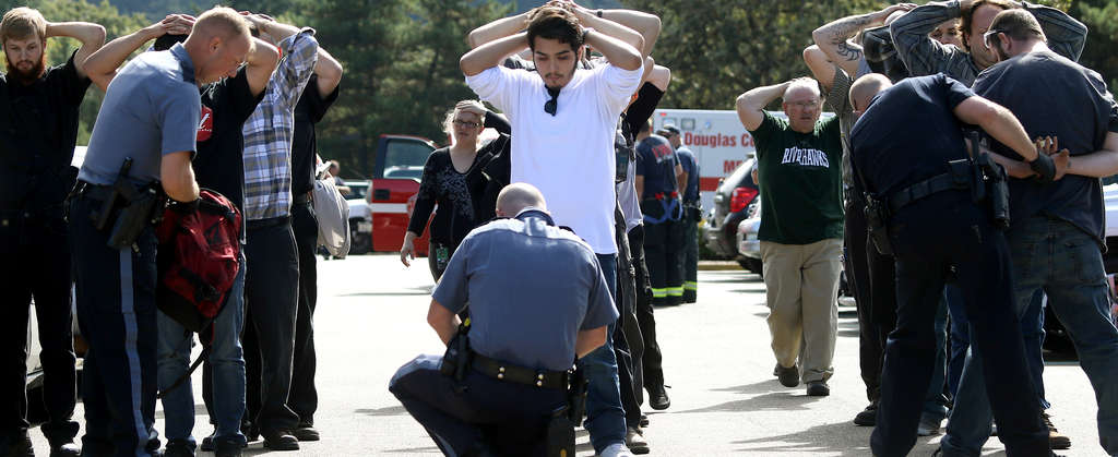 Police search students outside Umpqua Community College in Roseburg, Ore., after the carnage.