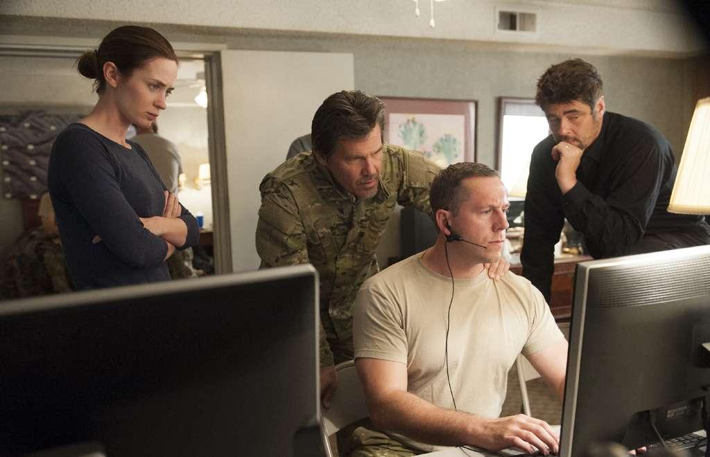 "The dark, suspenseful drug-war thriller ""Sicario"" stars Emily Blunt, Josh Brolin (standing center), and Benicio Del Toro (right)."