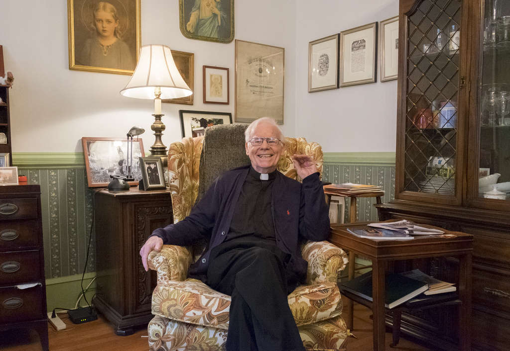 "Msgr. Michael Doyle in the living room of the Sacred Heart rectory. ""I always felt that if I ever became a pastor, I wanted to be in Camden,"" said Doyle, who turns 81 next month."