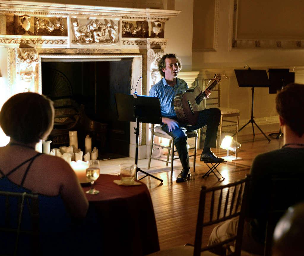Classical guitarist Brendan Evans talks with Stotesbury patrons.
