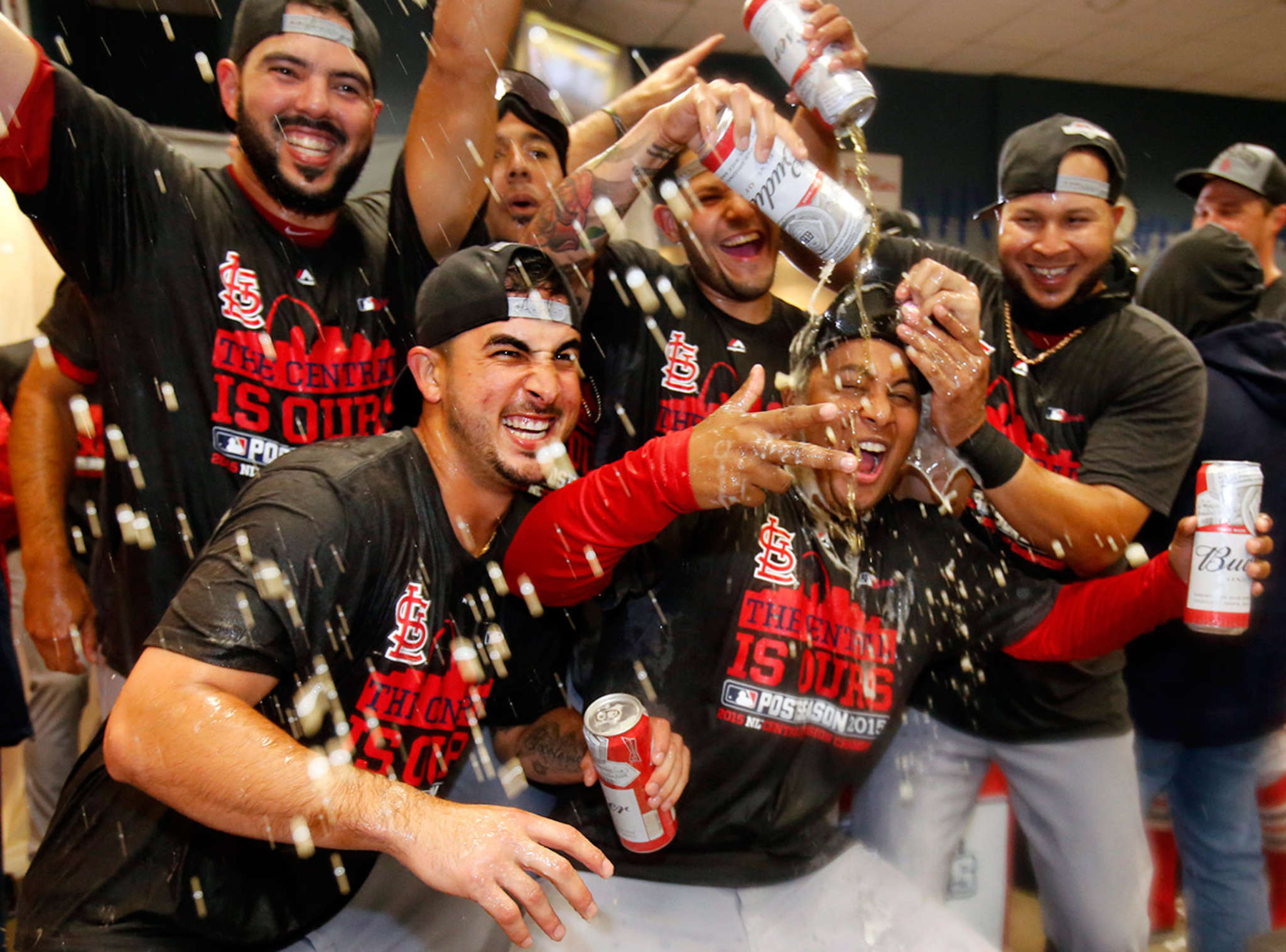 The Cardinals, celebrating their divisional title this year, redeemed themselves in our hearts by popping the beer tabs instead of the Champagne corks. But they´re still all wet.