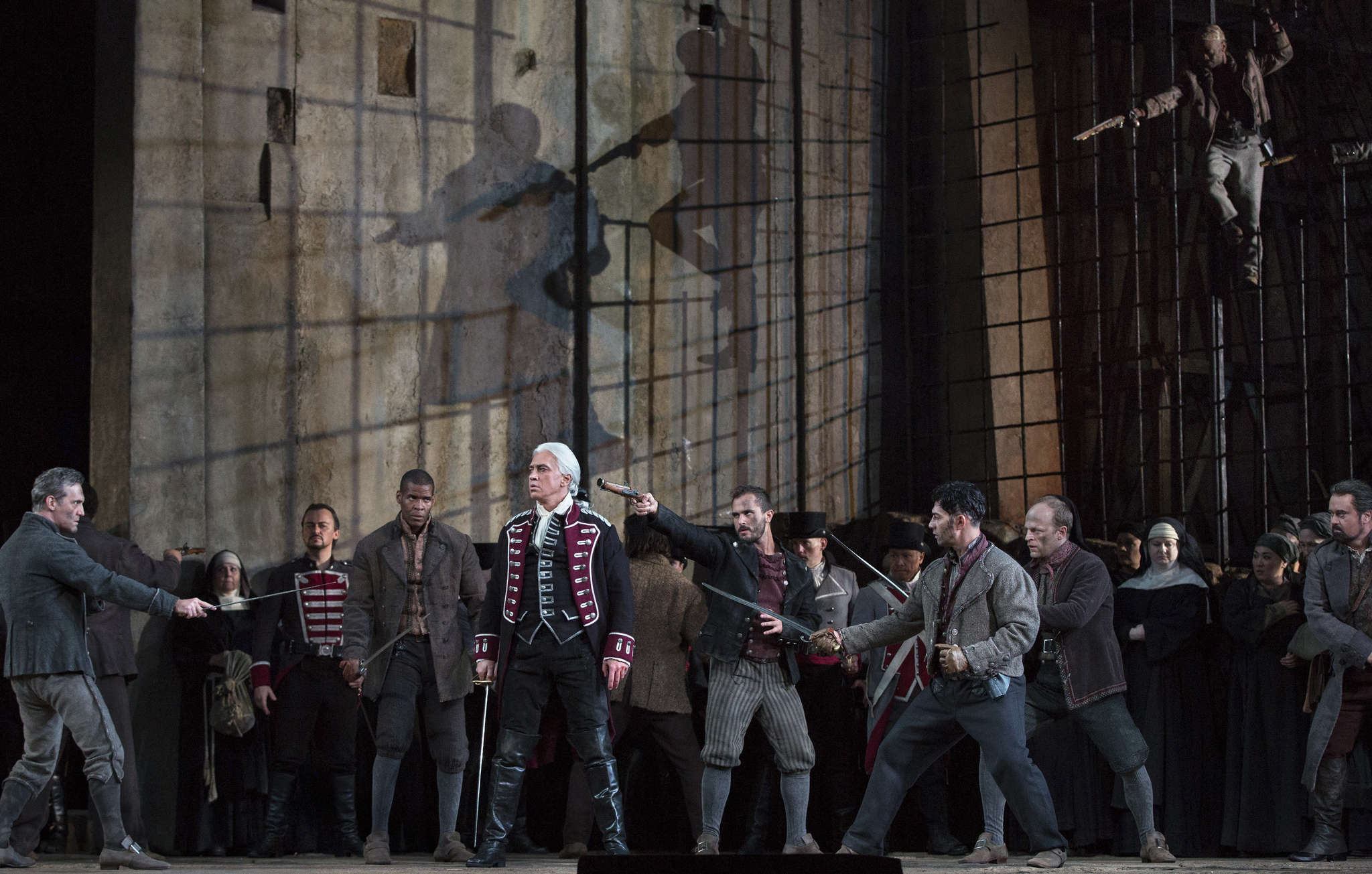 """Dmitri Hvorostovsky (foreground) in the Metropolitan Opera´s Oct. 3 production of """"Il Trovatore."""" """"We owe him a lot,"""" Met general manager Peter Gelb said."""