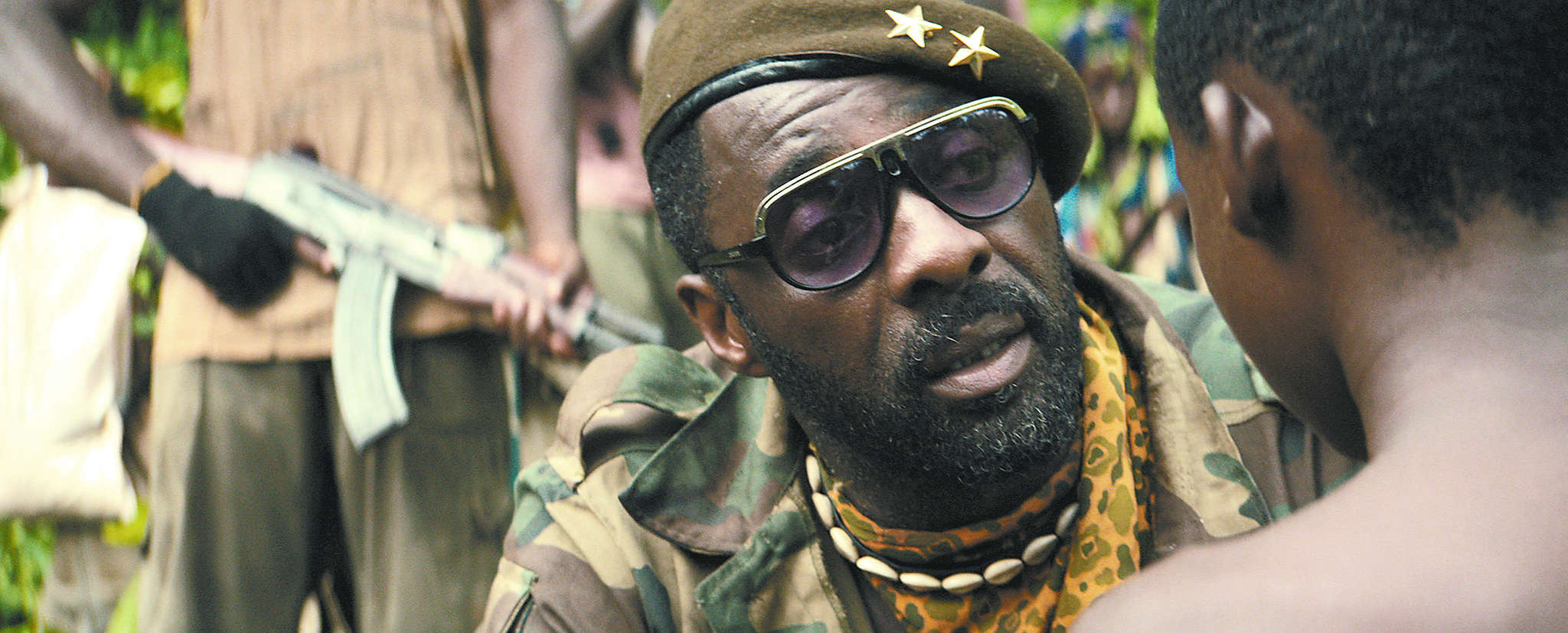 "Idris Elba as a brutal rebel commander in ""Beasts of No Nation."""