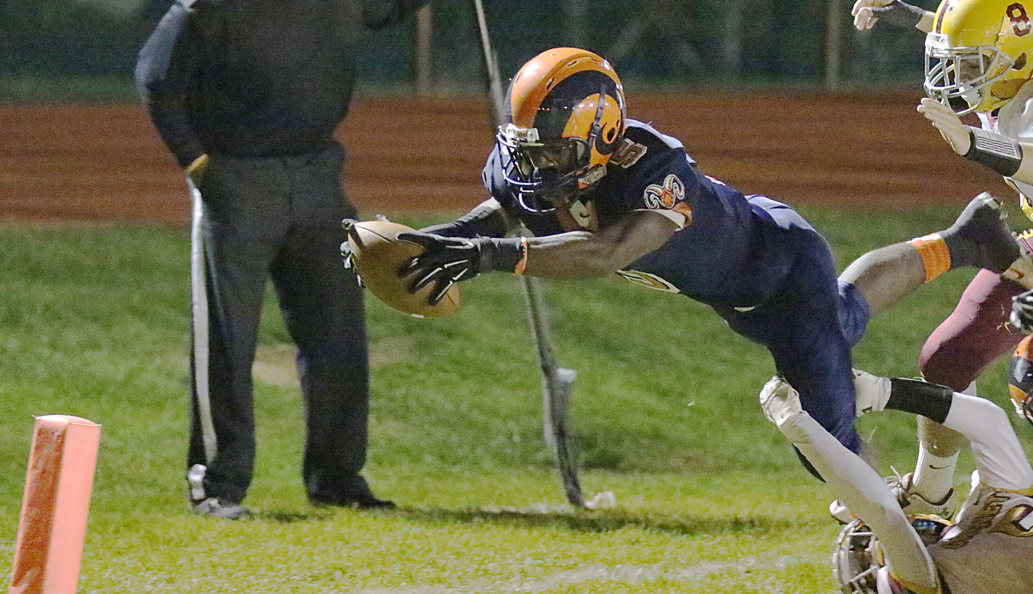 Overbrook´s Marques DeShields leaps for the end zone in the first quarter.