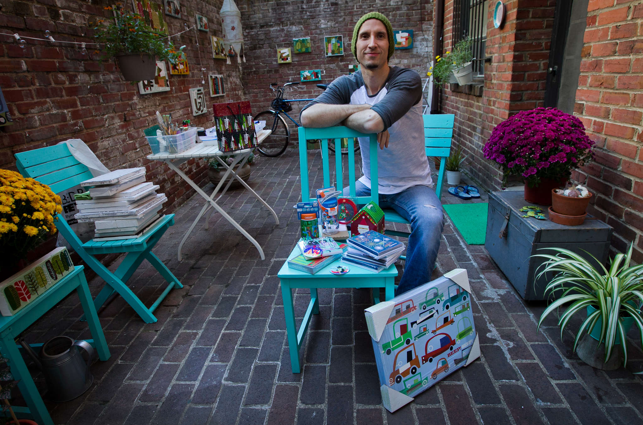 Artist Brian Love at his home and studio on Camac Street. Love has designed greeting cards, tissue boxes, and Macy´s mailers, but returned to Philadelphia to serve small businesses.