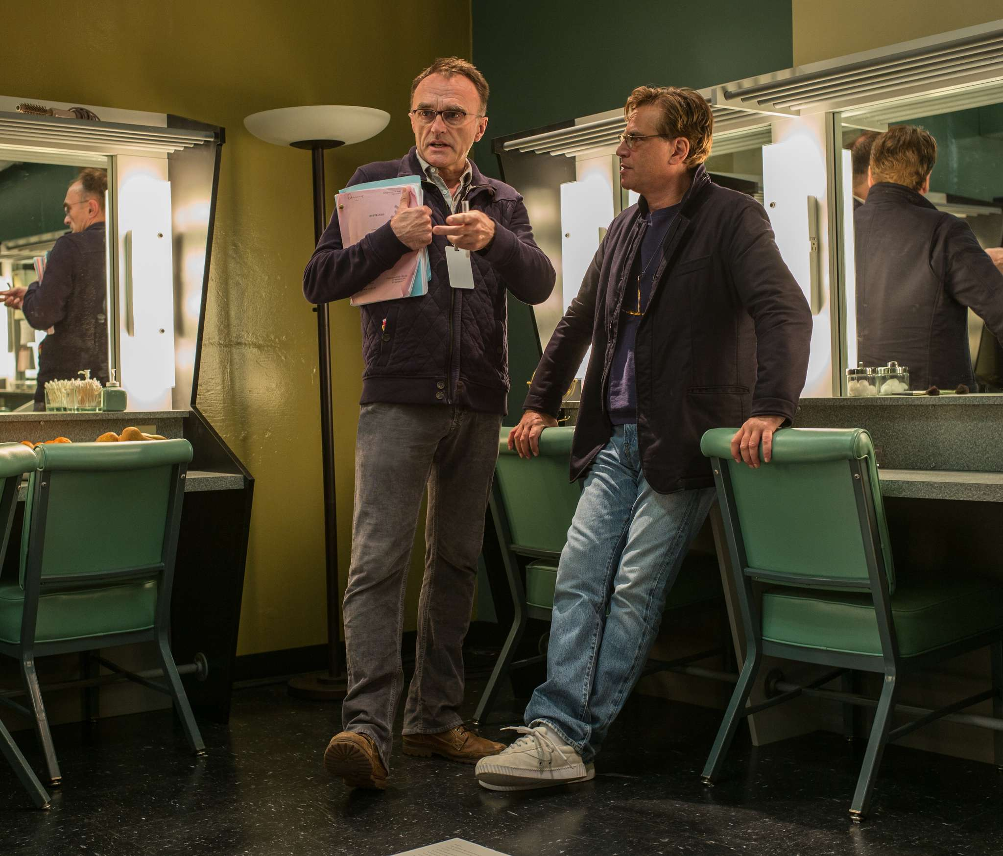 "Director Danny Boyle (left) and writer Aaron Sorkin chat on the set of ""Steve Jobs,"" a biography that zeroes in on three events in the visionary´s life. ""Before I knew what I wanted to do, I knew what I didn´t want to do, and that was write a biopic,"" Sorkin says."