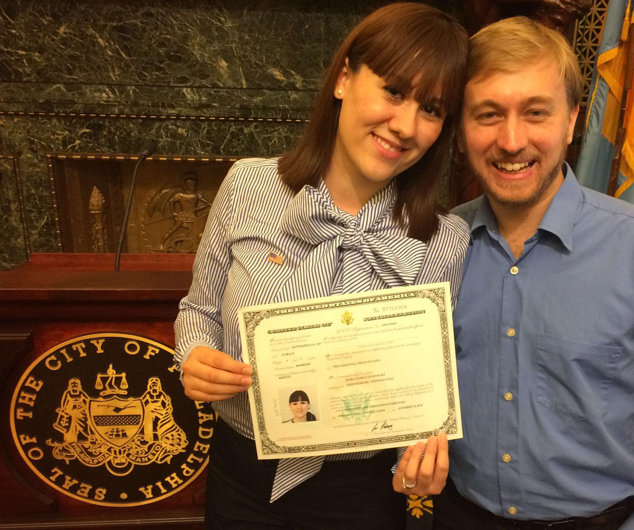 STU BYKOFSKY / DAILY NEWS STAFF Karla Marquez Eisenhart shows citizenship certificate alongside her husband, Michael Eisenhart.