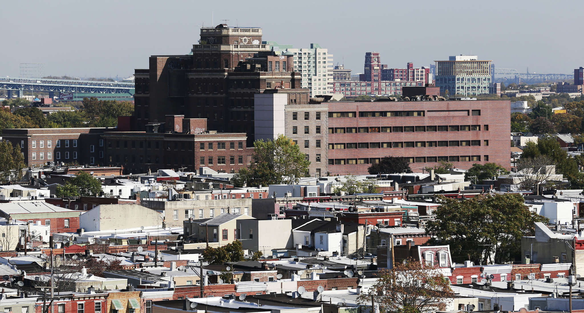"A cluster of rowhouses will be built over the remains of Mount Sinai Hospital. Critics have accused the developers of planning ""gated communities."""