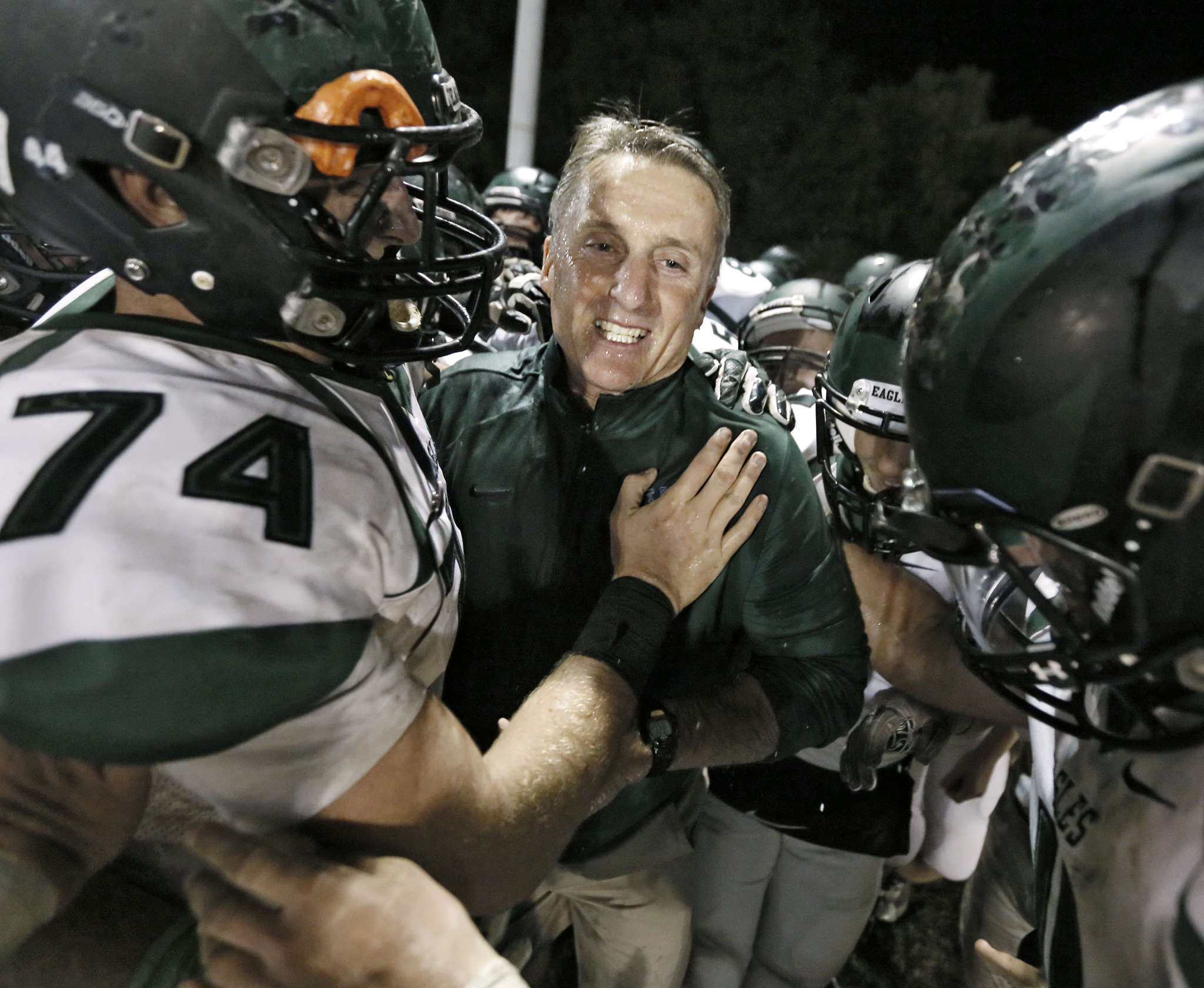West Deptford´s John Barrett (74) hugs head coach Clyde Folsom after the Eagles´ win. Folsom is 200-59-2 at West Deptford and is the ninth South Jersey coach to hit 200 wins at one school.
