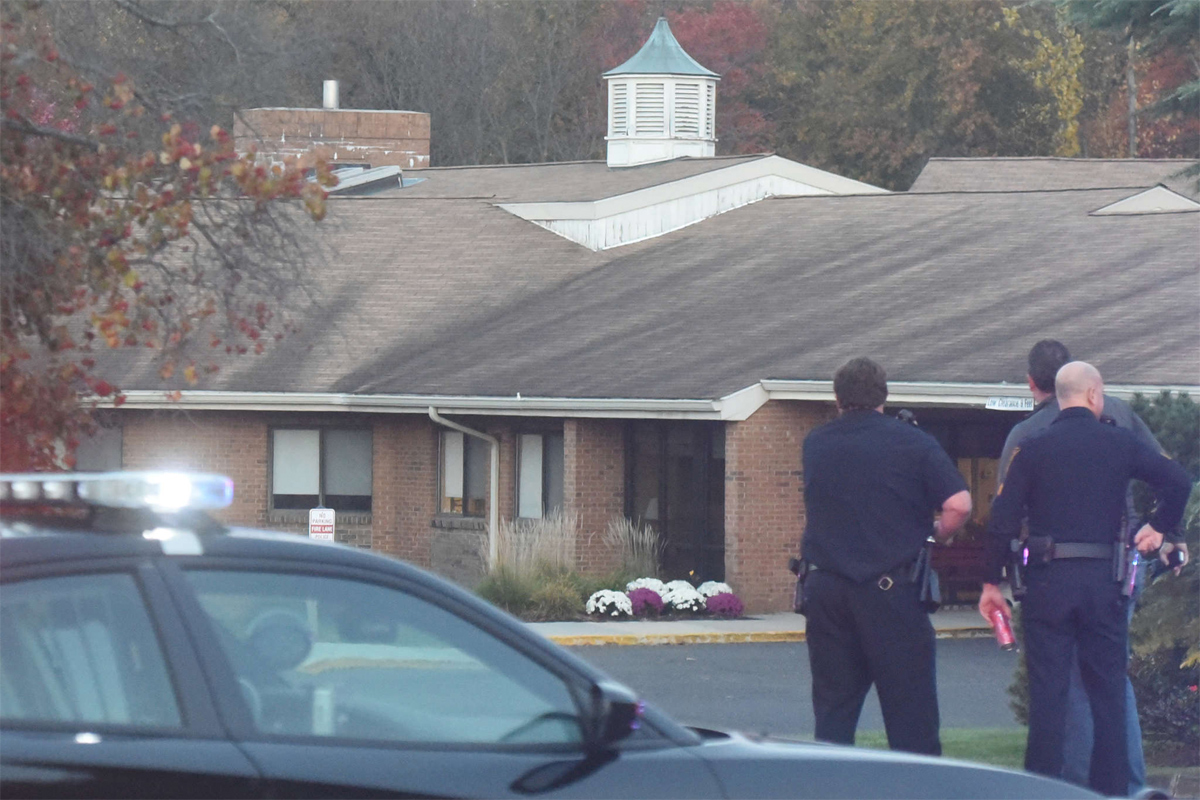Police stand by outside the Genesis HealthCare Voorhees Center after what police described as a murder-suicide there Sunday.
