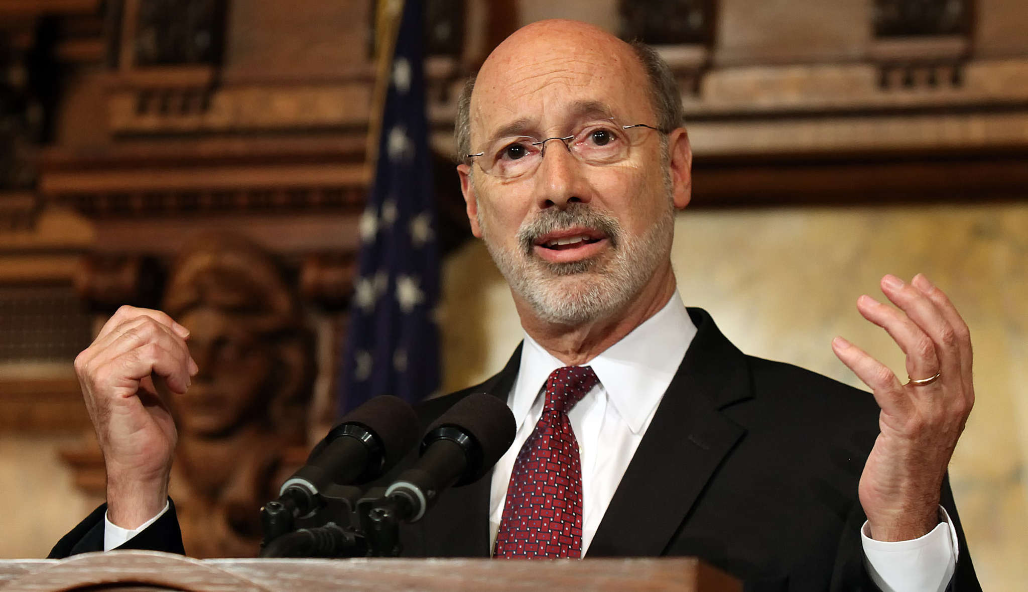 CHRIS KNIGHT / ASSOCIATED PRESS Unlike our state legislators , Gov. Wolf isn´t getting his salary, but that´s just because he donates it.