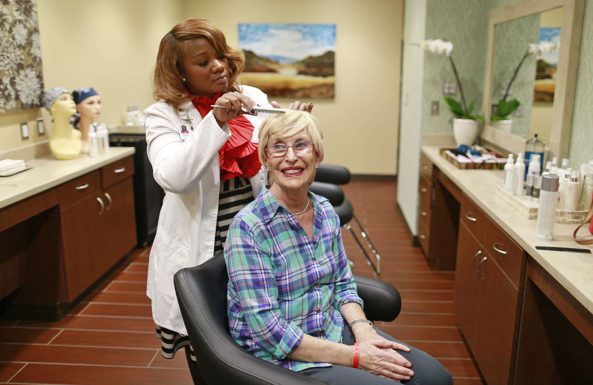 In the full-service salon at Cancer Treatment Centers of America in the Northeast, Denise Foster-Hoagland styles a wig for patient Elizabeth Key.