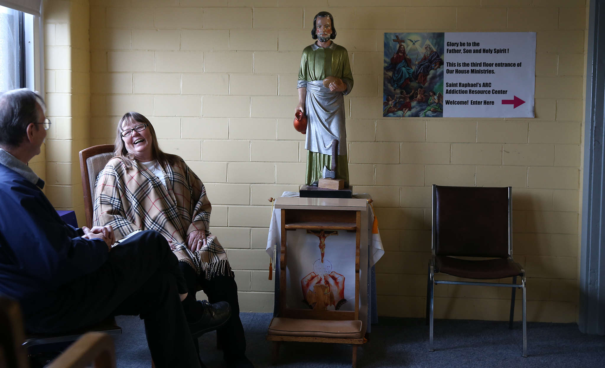 DAVID MAIALETTI / STAFF PHOTOGRAPHER Father McKay talks with volunteer Kathy Diering, who runs the facility to help addicted women.