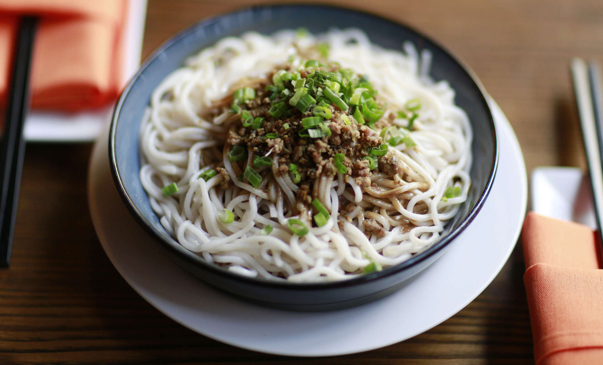 The dandan noodles come in a hot balm of chili oil and minced pork at DanDan, 126 S. 16th St.