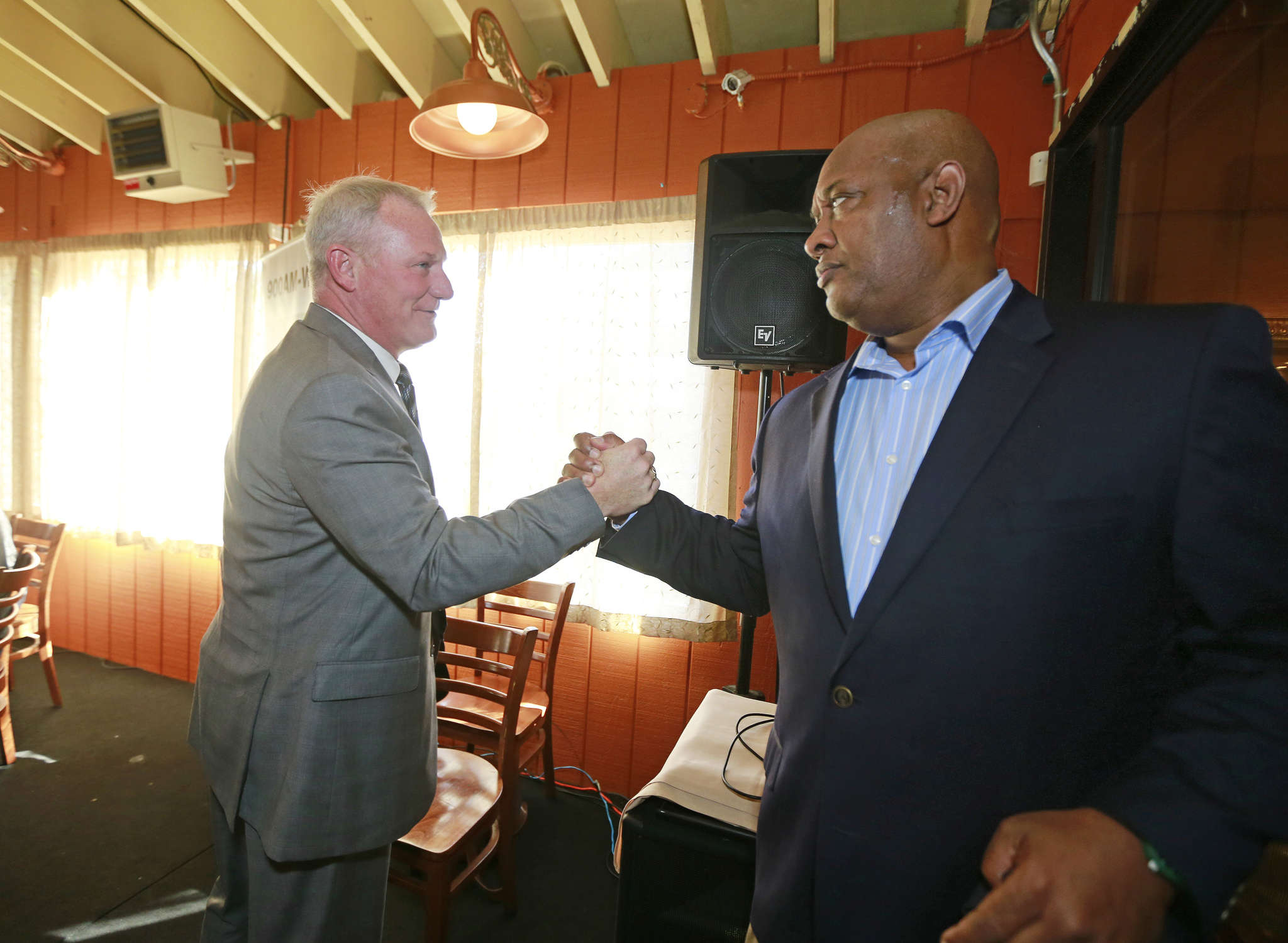 DAVID SWANSON / STAFF PHOTOGRAPHER Judge Kevin Dougherty (left) with state Rep. Dwight Evans yesterday at Relish on Ogontz Avenue.