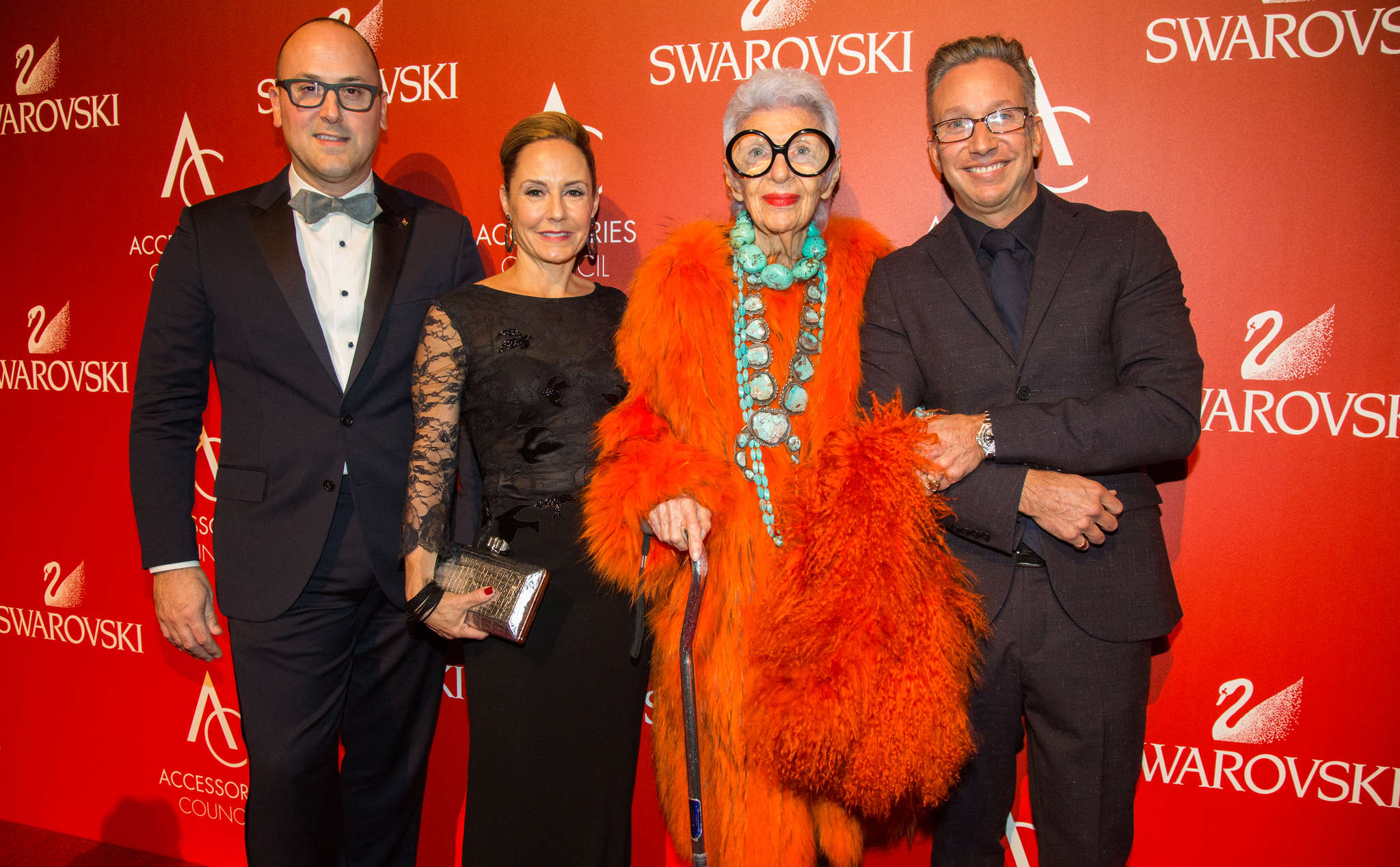 At the event are (from left) Accessories Council board chairman Frank Zambrelli, board president Karen Giberson, accessories icon Iris Apfel, and her companion.