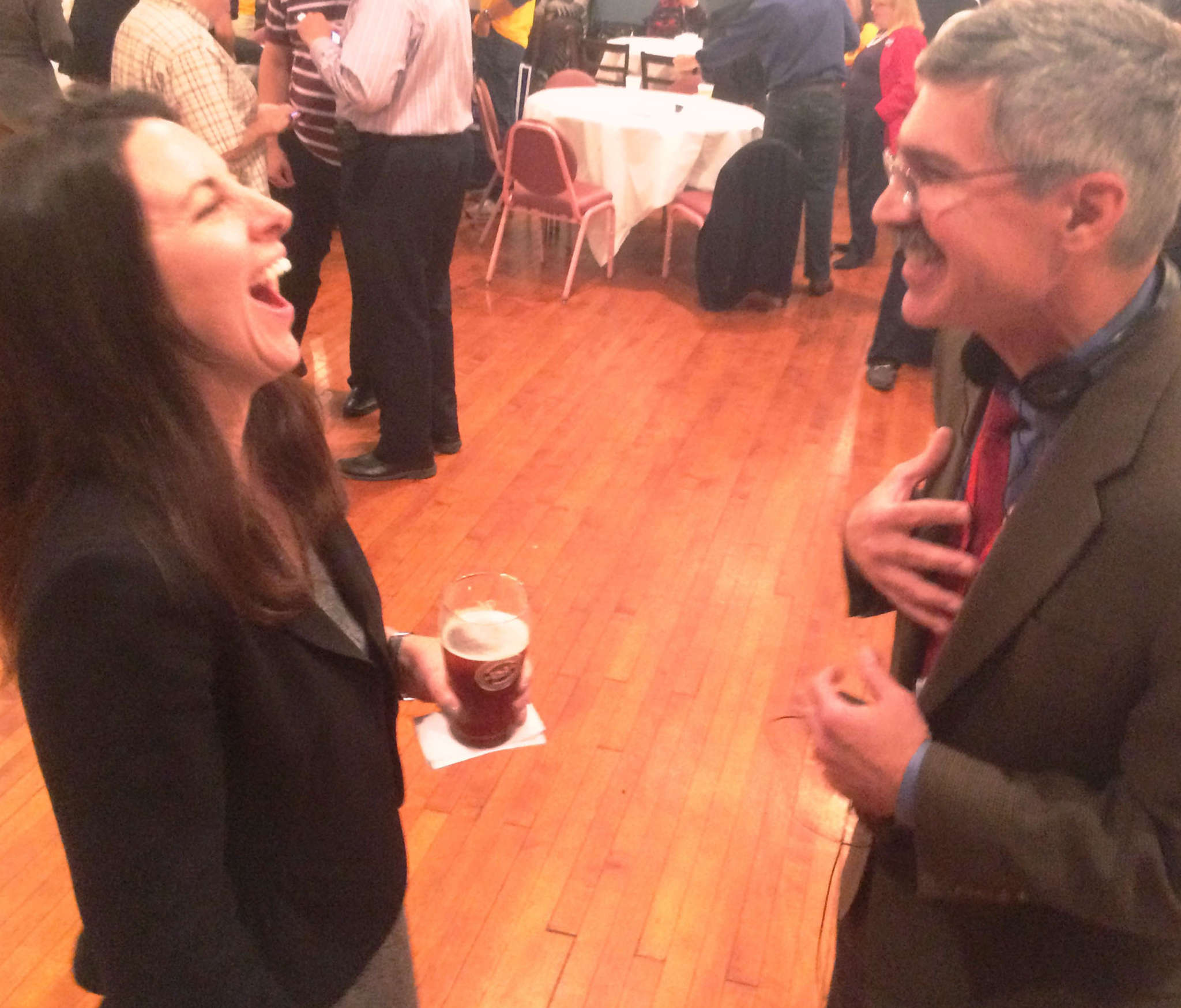 STU BYOFSKY / DAILY NEWS STAFF Republican mayoral candidate Melissa Murray Bailey enjoys a beer and laugh with KYW NewsRadio reporter Mike DeNardo after the polls closed Tuesday night.