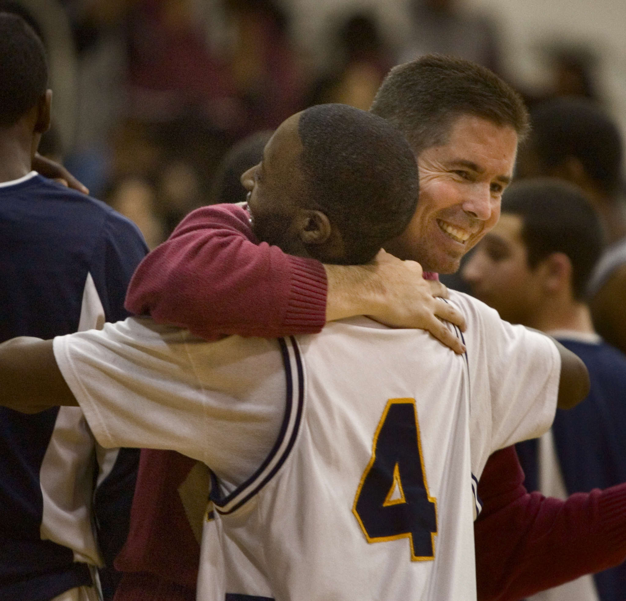 Then-Collingswood coach Joe McLoughlin hugs Tawan Austin after a 2007 win. Not rehired in 2012, he sued the district, saying he was let go for resisting pressure to include more white players on his team. He dropped the suit for a $250,000 settlement.
