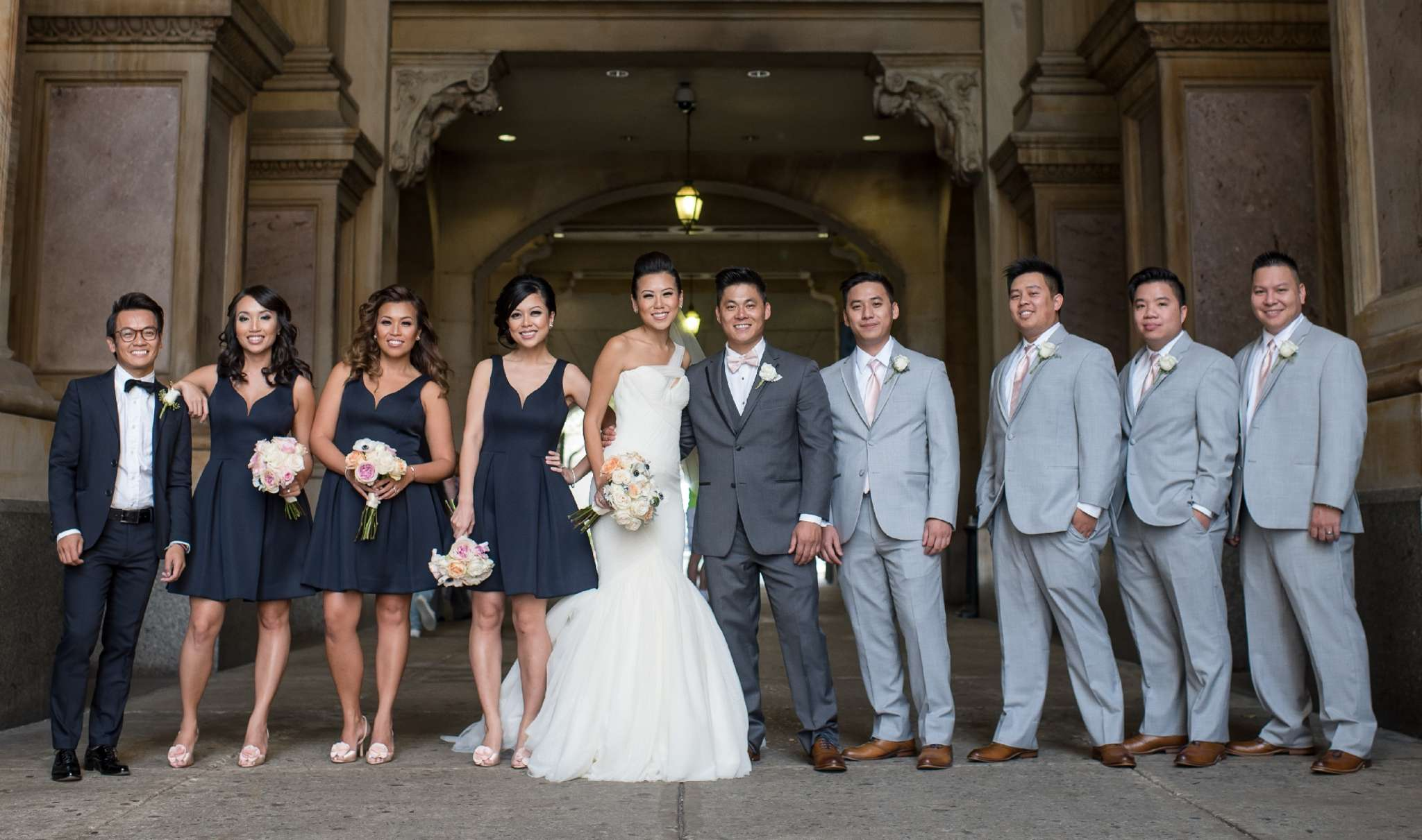 Wedding attendants with the couple: (from left) Tony Le, Le Tran Notarfrancesco, Annette Tran, Holly Do Nguyen, Trang Do, Kevin Nguyen, Chau Nguyen, Cong Nguyen, Darius Nguyen, and Steve Nguyen.