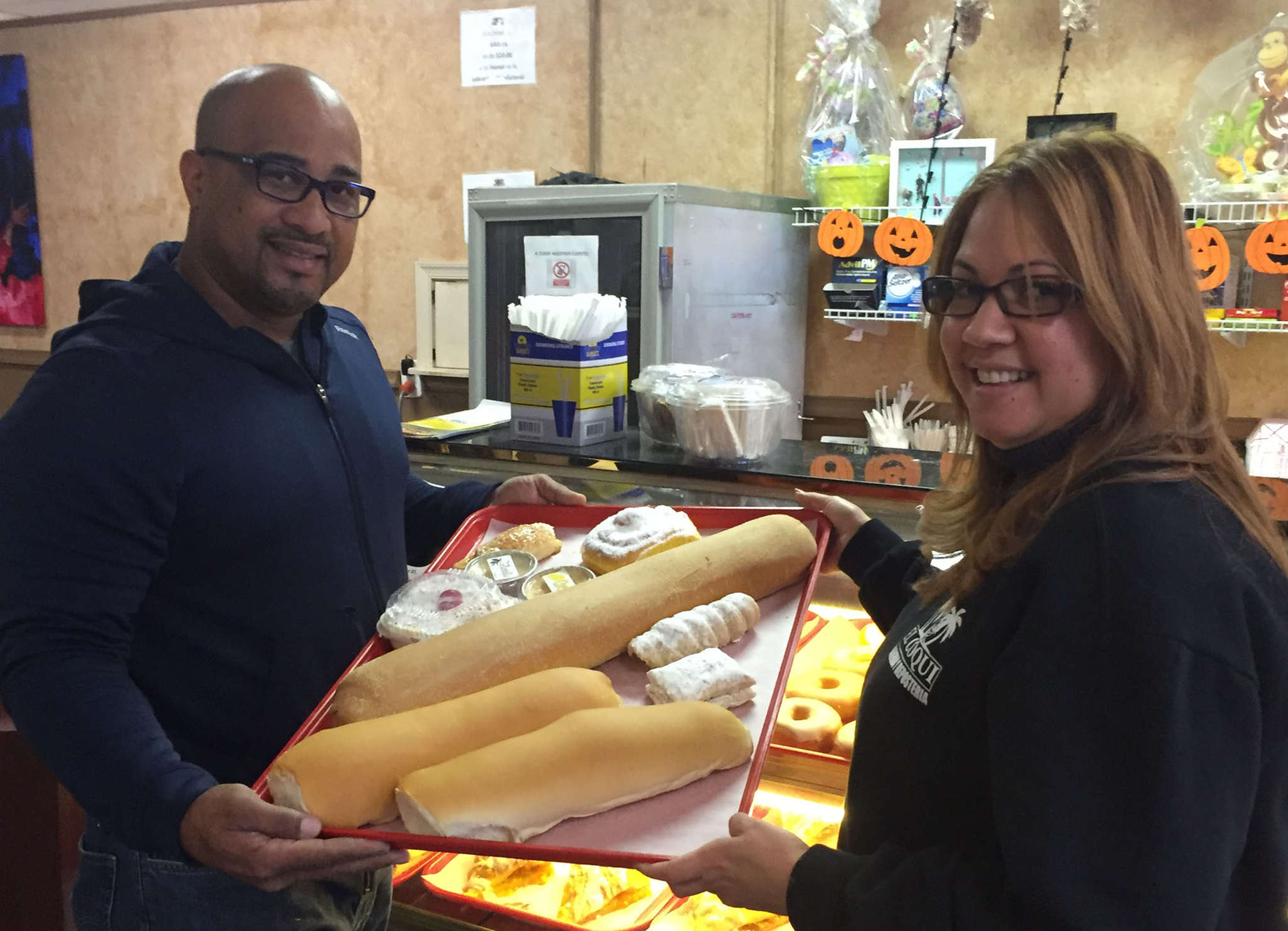 MICHAEL HINKELMAN / FOR THE DAILY NEWS El Coqui co-owners Cesar Guzman and Yazmin Auli say their bakery´s Puerto Rican pastries attract customers from throughout the East Coast.
