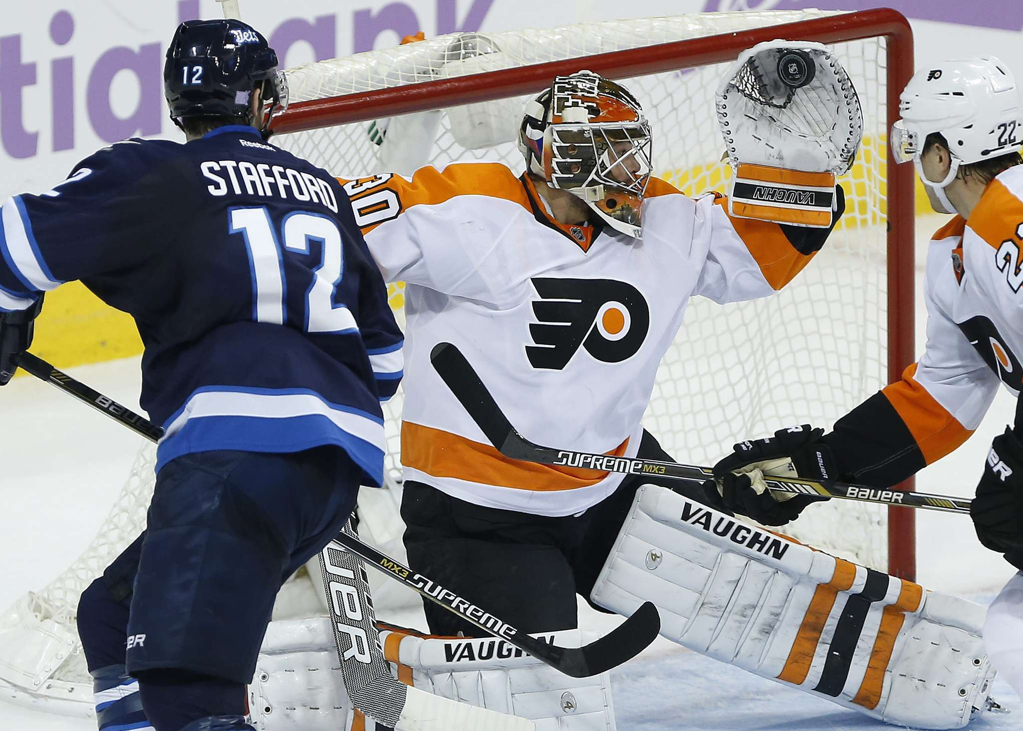 Flyers goaltender Michal Neuvirth (center) is tied for the league lead in shutouts (three) and save percentage (.945).