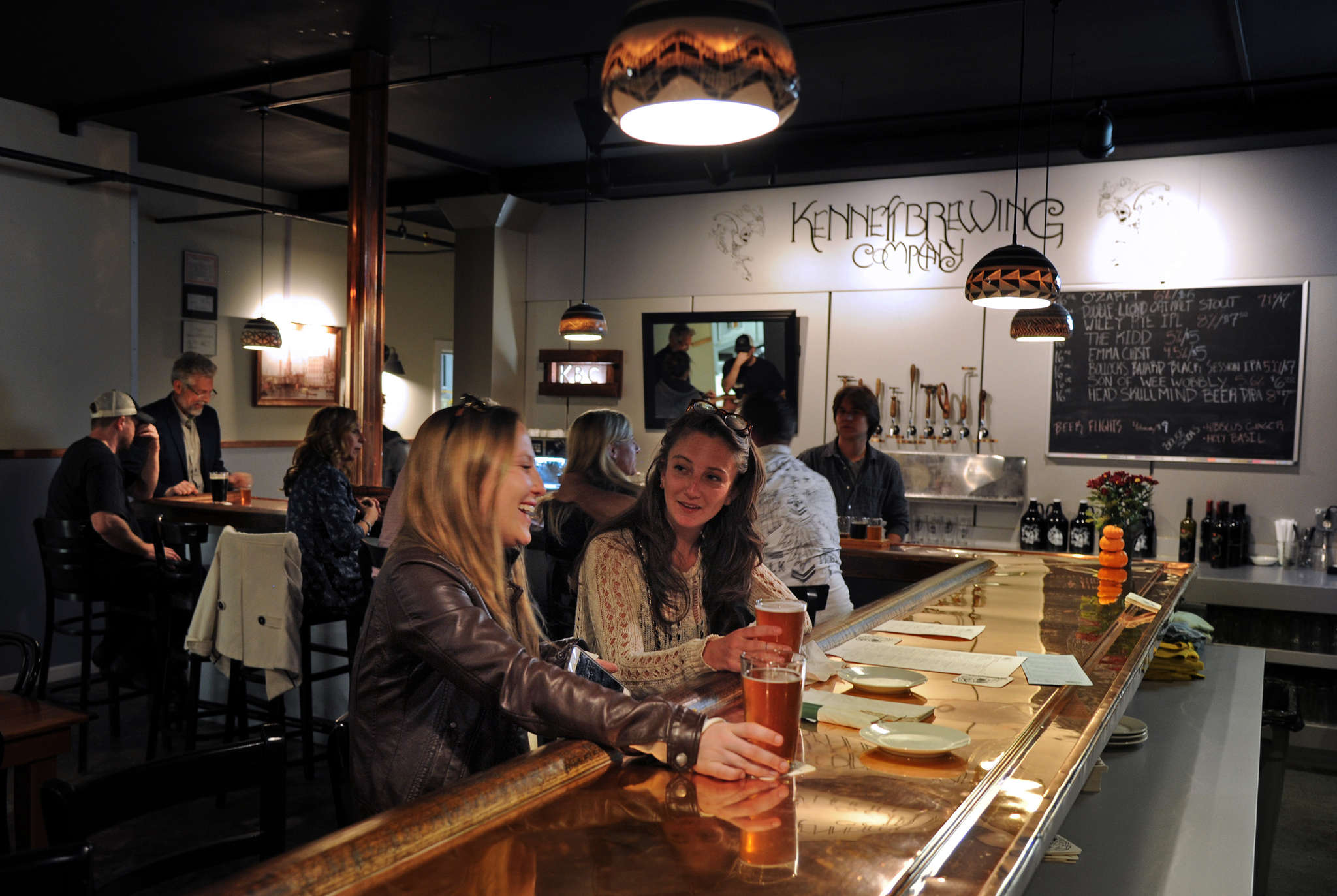 Sisters Caroline (left) and Lauren Brunovszky, both of Kennett Square, at the bar at Kennett Brewing Co.