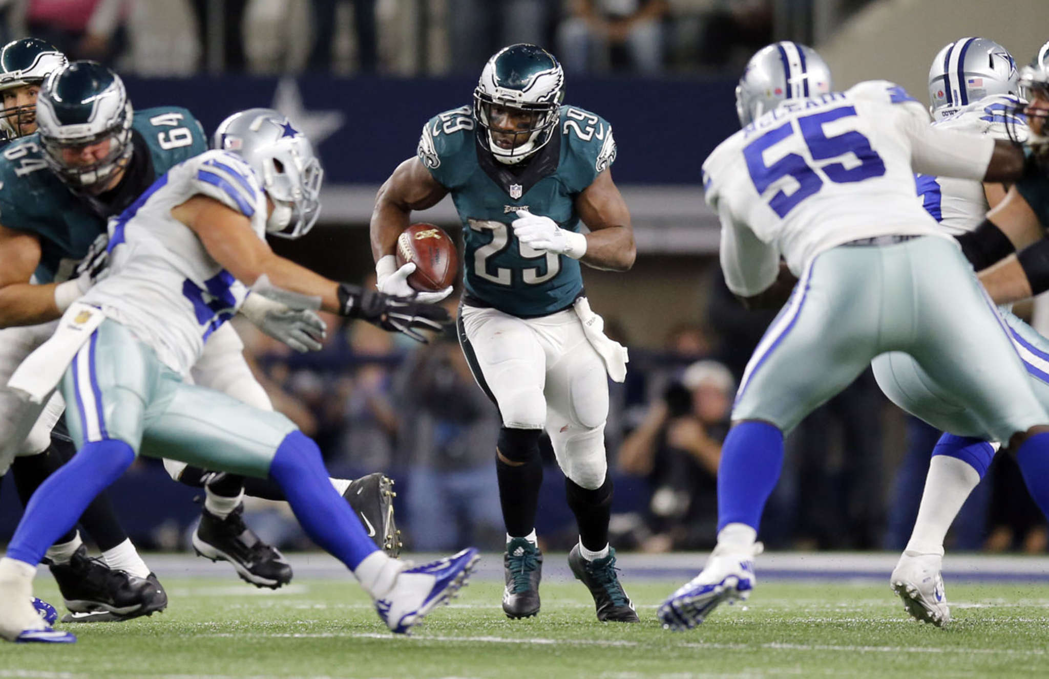 DeMarco Murray bursts through a hole in the win against Dallas. He gained 83 yards on 18 carries.