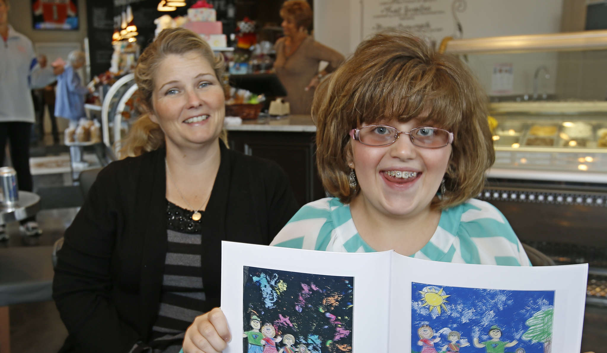 Ella Wilson, 9, a.k.a. Ella Mozzarella with her mother, Terri, at the Classic Cake Store in Cherry Hill. Ella will read her book in the store Sunday.