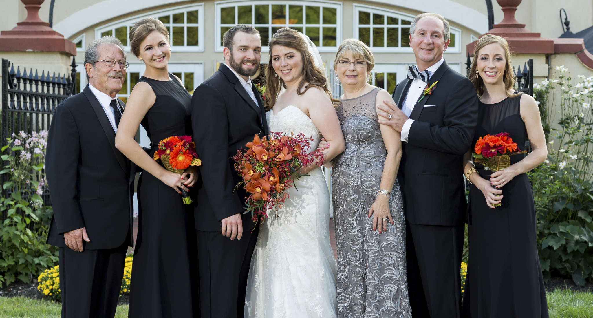 Family of the bride: (from left) pop-pop Giuseppe Macolino; Allison Macolino; newlyweds Michael Kane and Christine Macolino; mother and father of the bride, Majella and Paul Macolino; and Lauren Macolino.