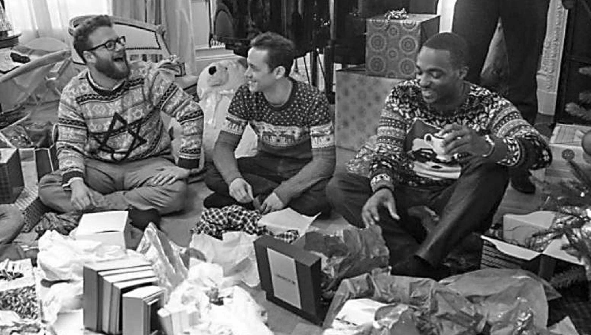 "Seth Rogen (from left), Joseph Gordon-Levitt and Anthony Mackie grow up, sorta, in ""Night Before."""
