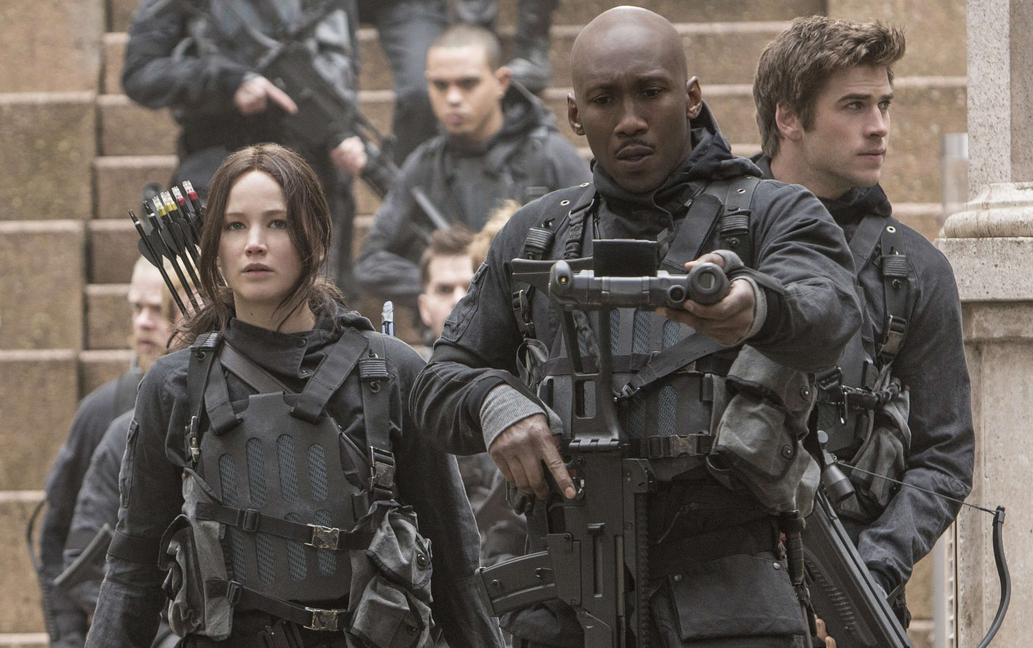"Jennifer Lawrence as Katniss Everdeen, with Mahershala Ali (center) and Liam Hemsworth, in ""The Hunger Games: Mockingjay - Part 2,"" the last of the four-film series about a dystopian future."