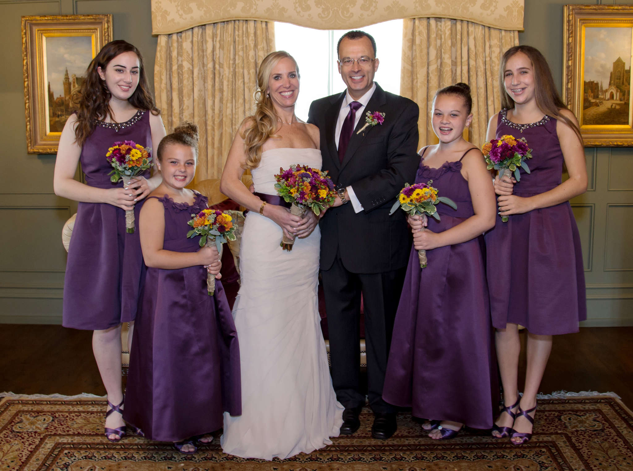 Together as a new family, newlyweds Jaimi Gordon and Ron Blackburn with (from left) Jaimi´s daughter Alexandra, Ron´s daughter Allison, Ron´s daughter Elisabeth, and Jaimi´s daughter Isabelle.