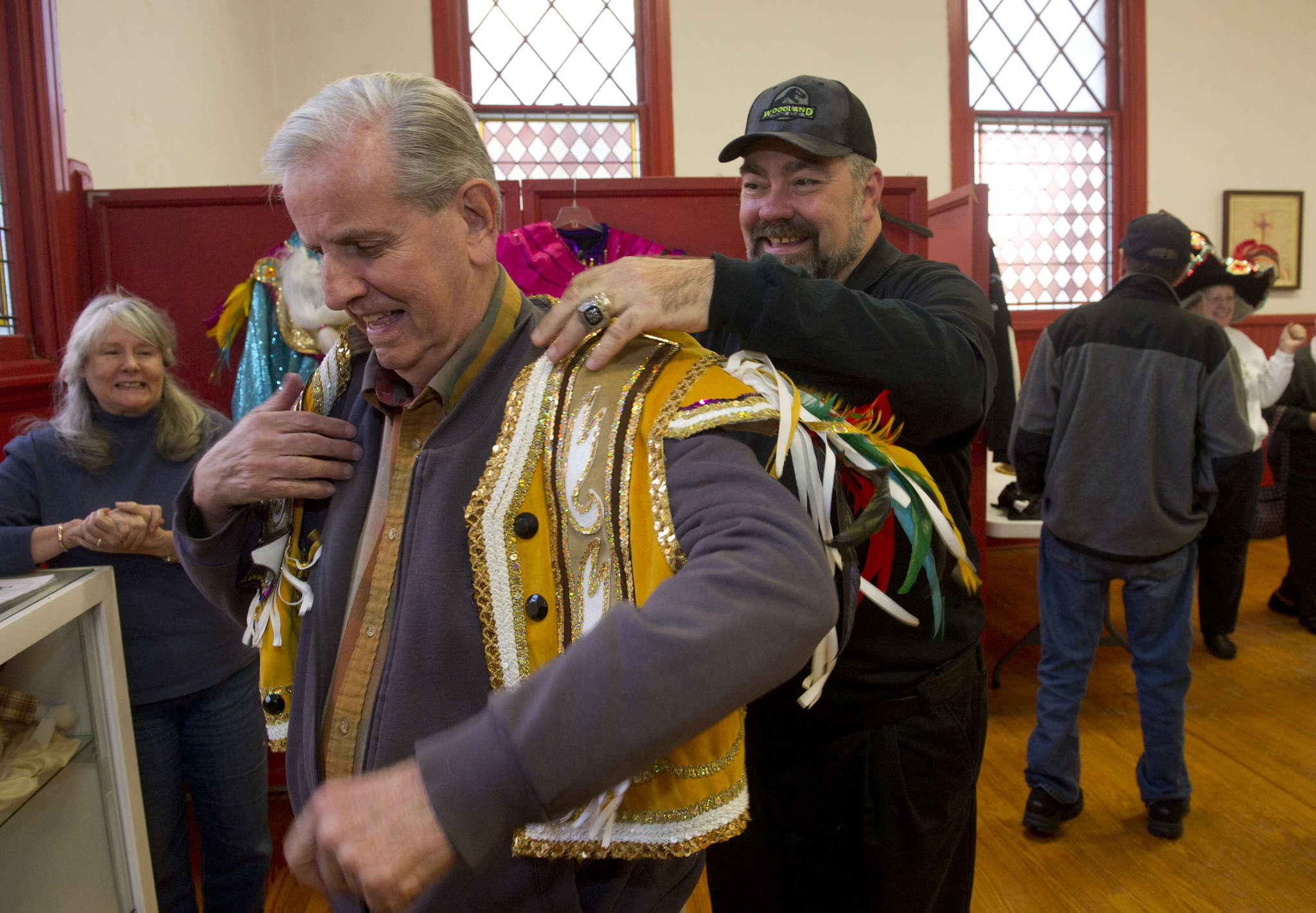 Alan Visitacion (right) helps John Kraus try on a costume during Visitacion´s Mummers presentation.