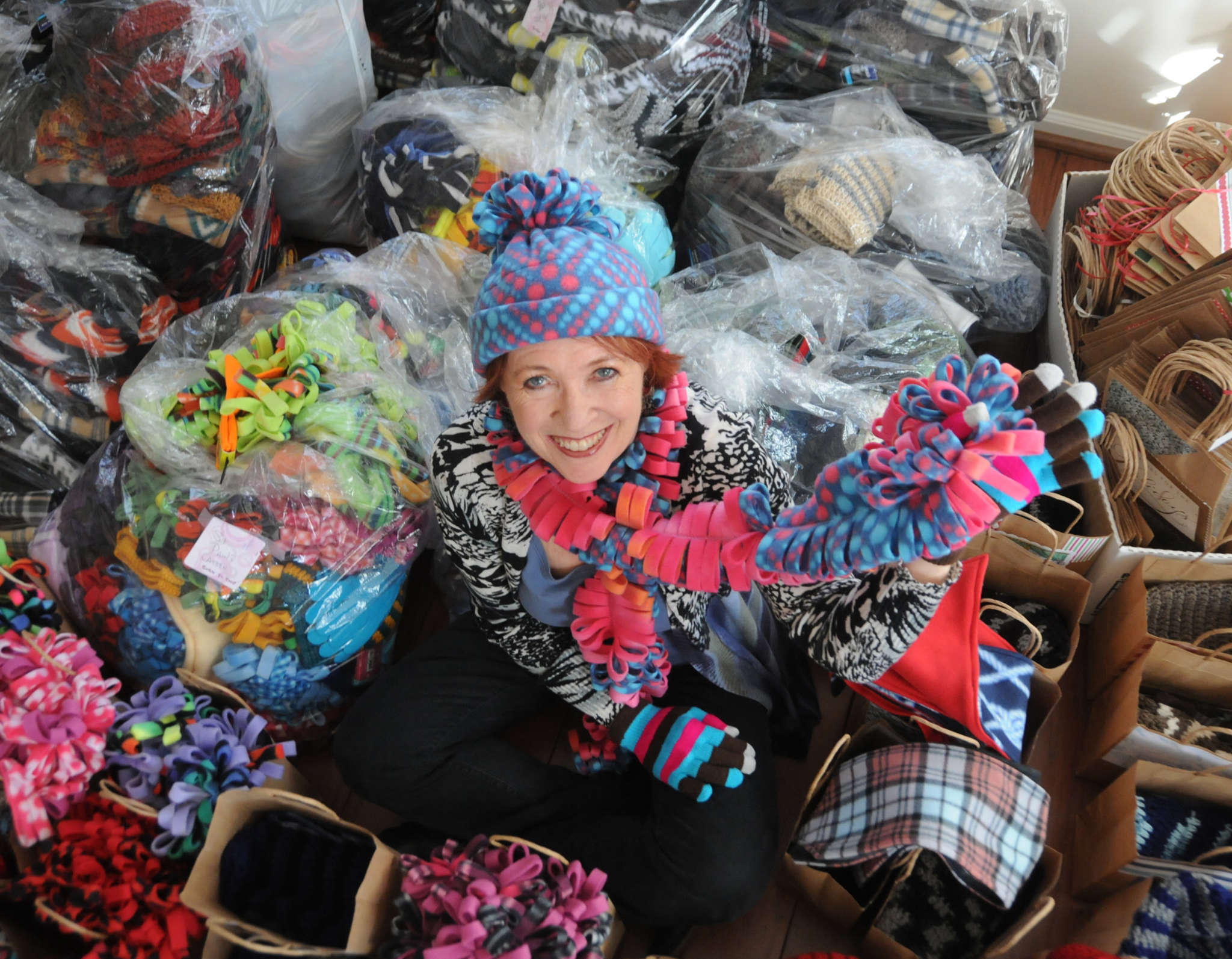 """To me, this is a calling,"" says Camille Scott, with holiday packages for the homeless that include her handmade hats and scarves. The Voorhees retiree calls her ministry Warm Hands, Warm Hearts."