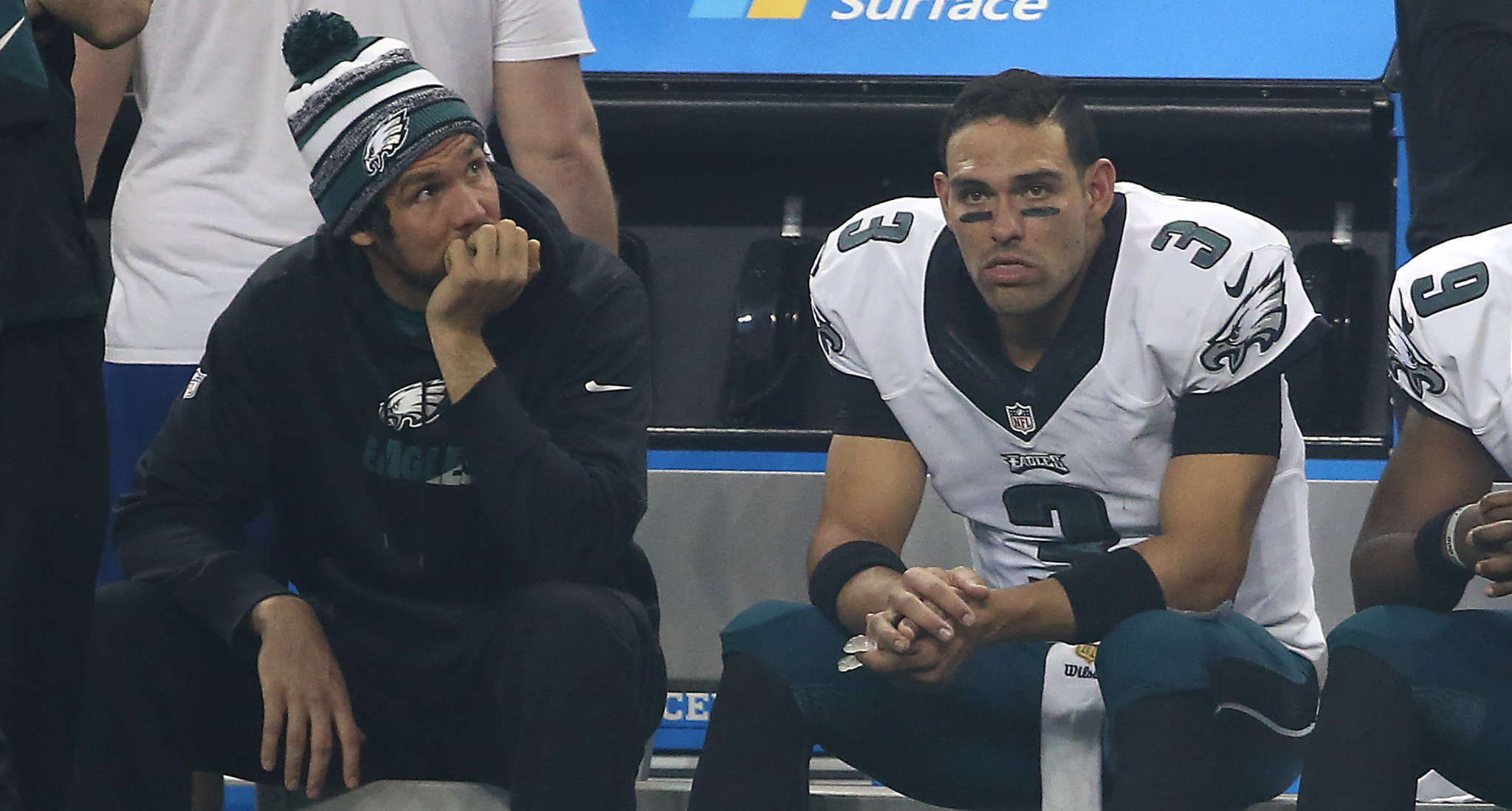 Eagles´ quarterbacks Sam Bradford (left) and Mark Sanchez watch from the bench during the fourth quarter of a 45-14 loss to the Lions. Sanchez was sacked six times in the blowout in Detroit.