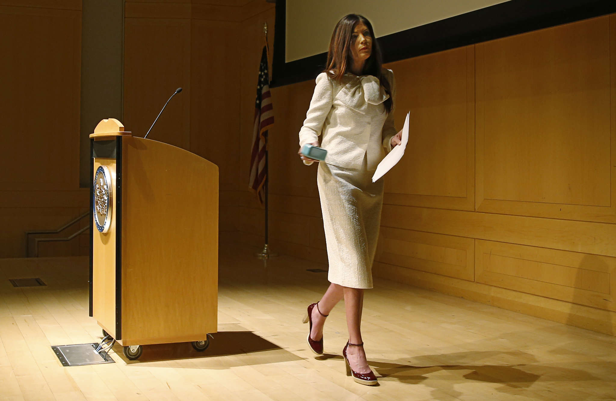 MICHAEL BRYANT / STAFF PHOTOGRAPHER Attorney General Kathleen Kane walks off stage without taking any reporter´s questions yesterday.