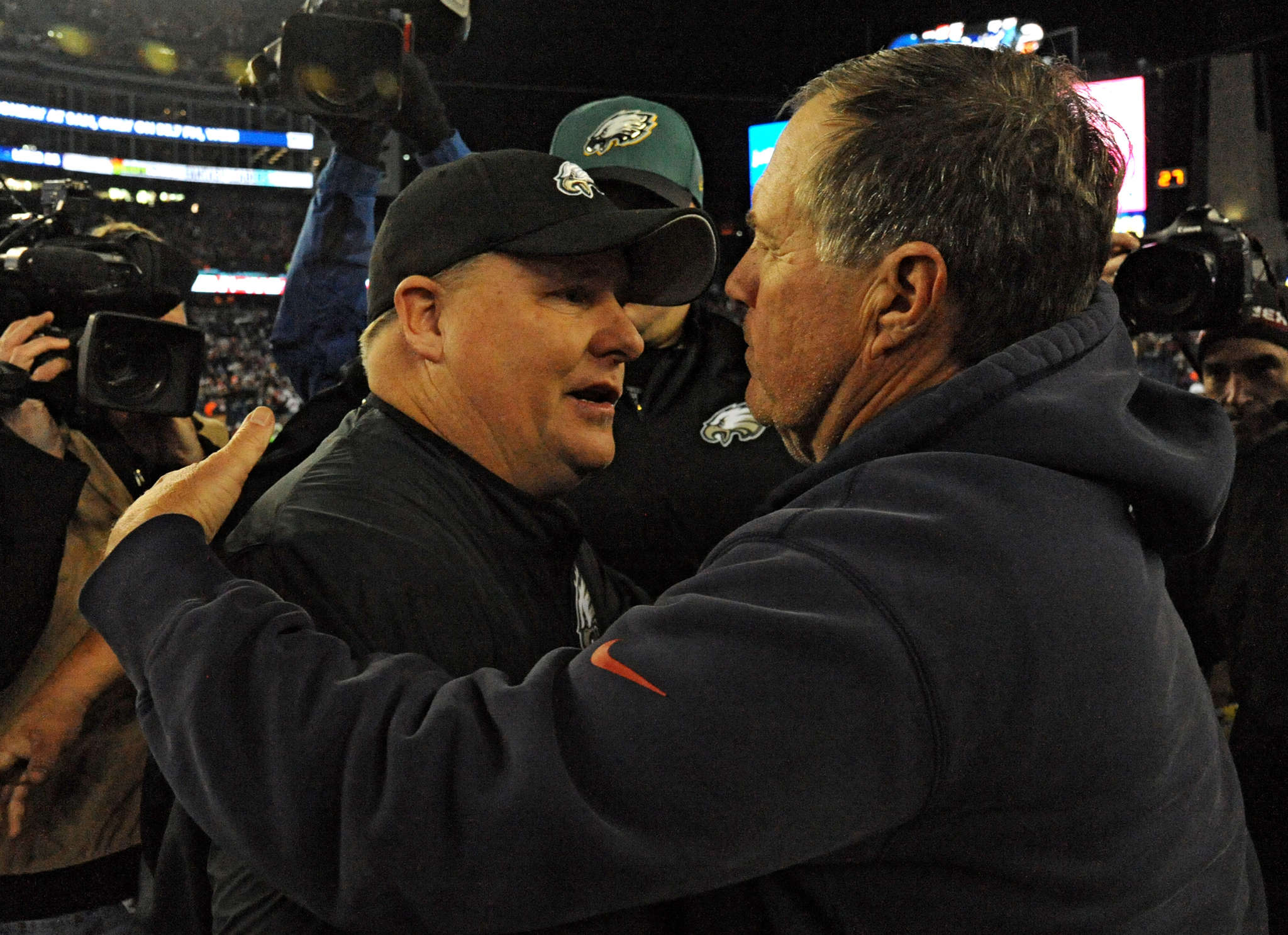 Patriots coach Bill Belichick (right) greets his Eagles counterpart, Chip Kelly, after the game, which was not the finest hour for New England´s four-time Super Bowl winner.