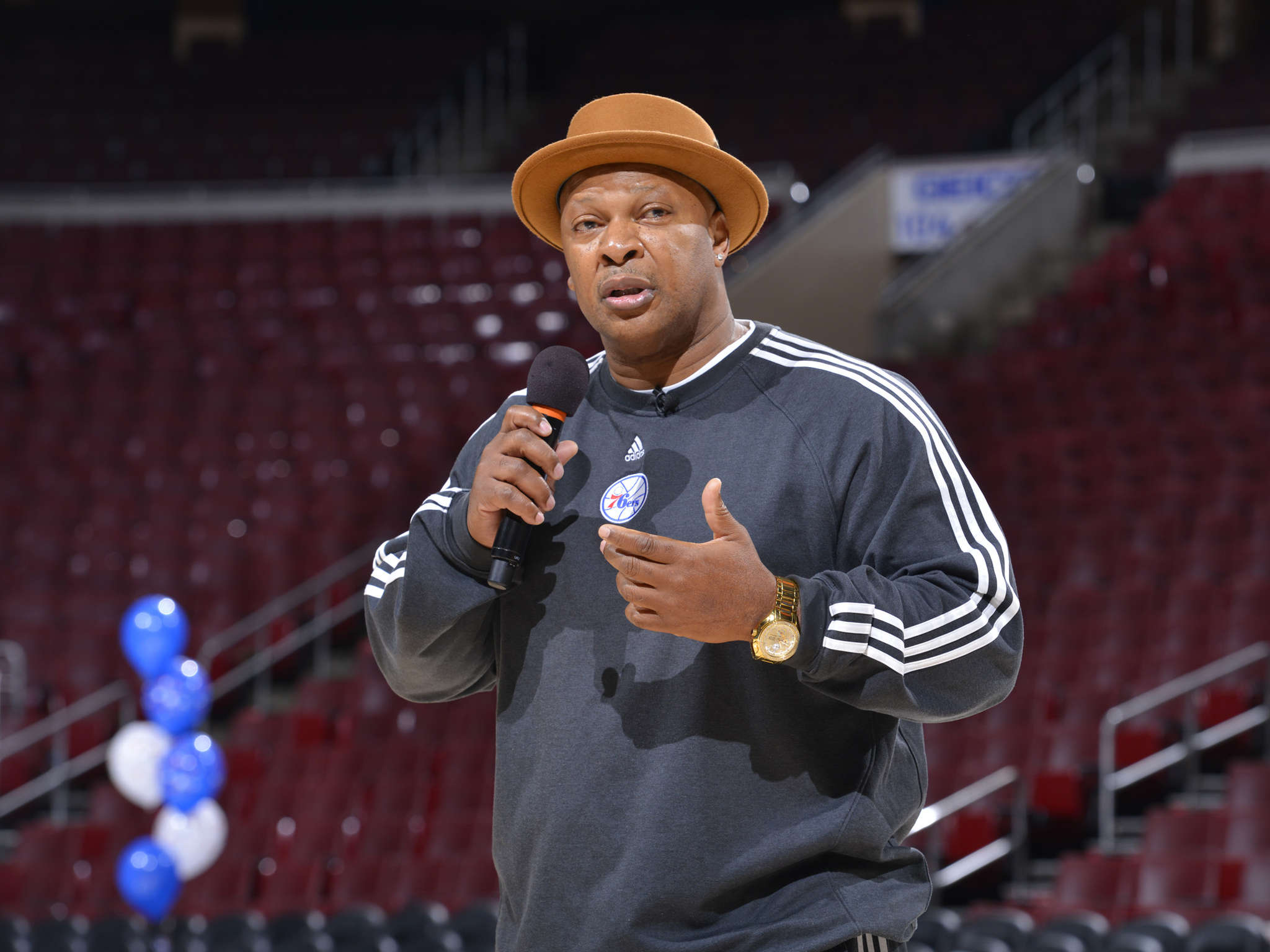 Former 76ers player World B. Free speaks at the Wells Fargo Center event for Philadelphia schoolchildren. Free has been critical of the Federal Reserve´s refusal to raise interest rates.