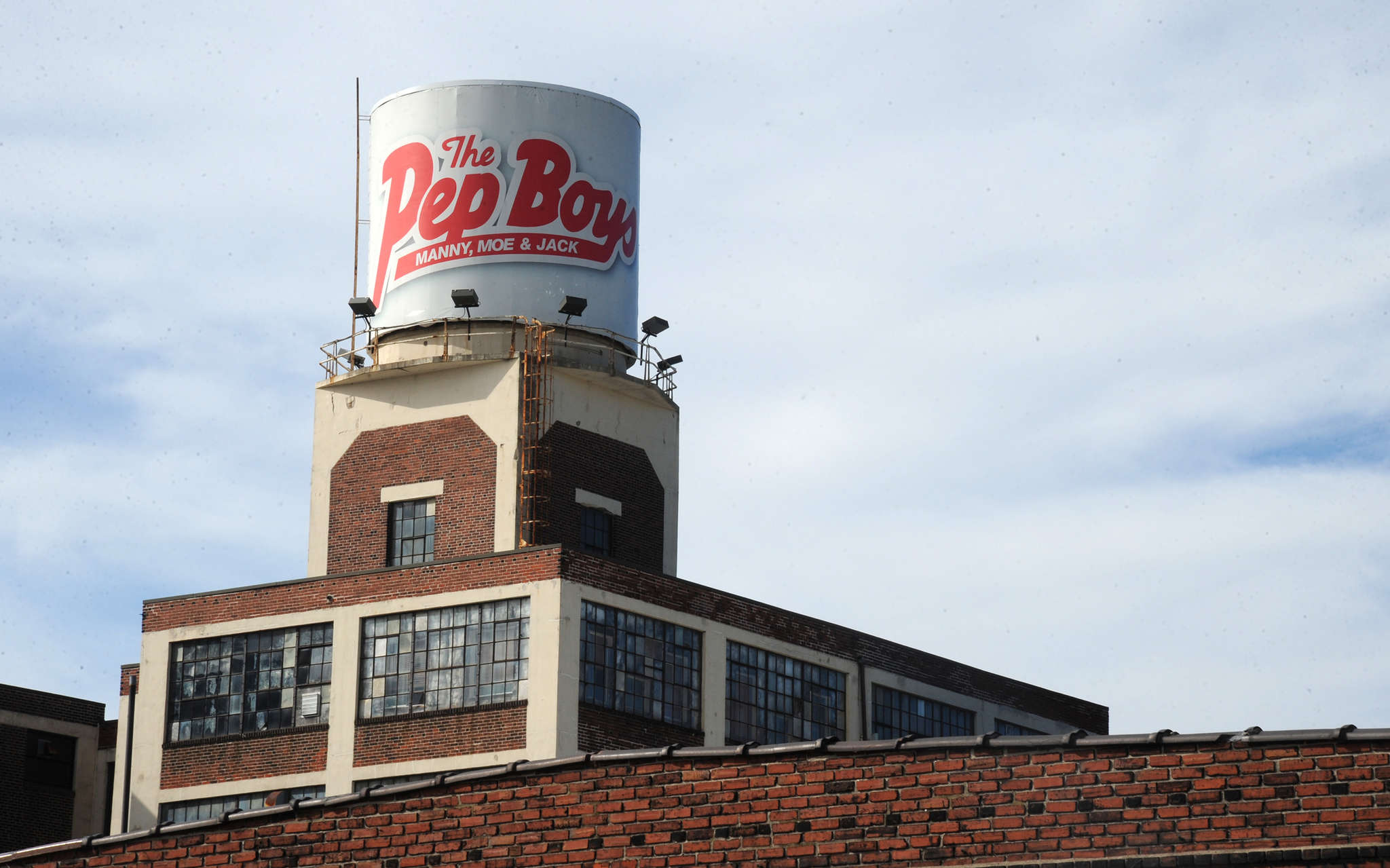 The Pep Boys sign on top of the headquarters on Allegheny Avenue, where 500 work. CLEM MURRAY / Staff Photographer
