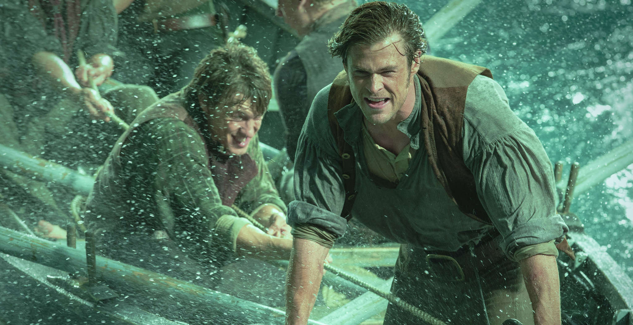 "Sam Keeley (left) and Chris Hemsworth row, row, row their boat in ""Heart of the Sea,"" but they may have bigger problems (below)."