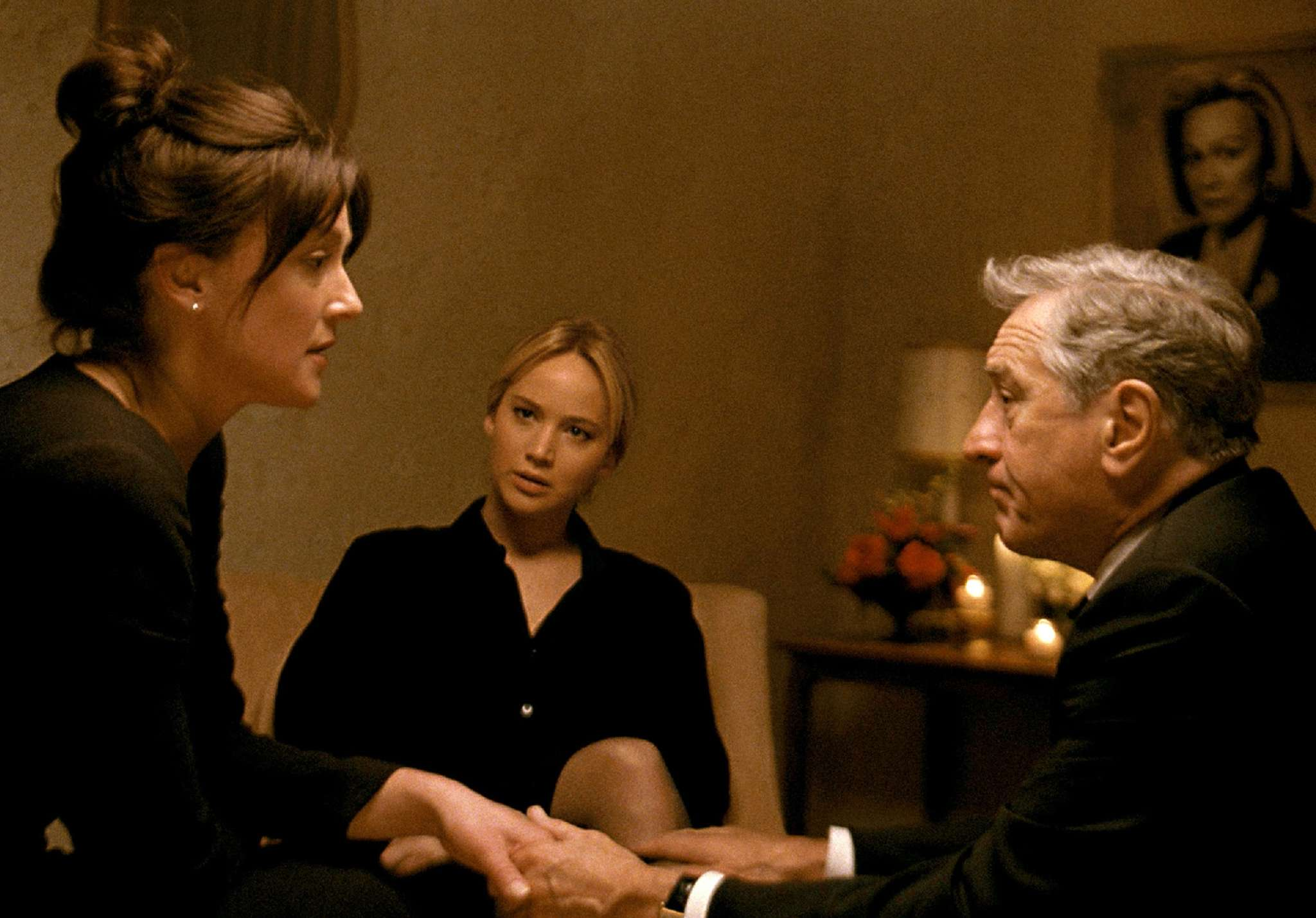 """Joy"" stars Jennifer Lawrence (center) in the title role, with Elisabeth Rohm as her sister and Robert De Niro as their father."