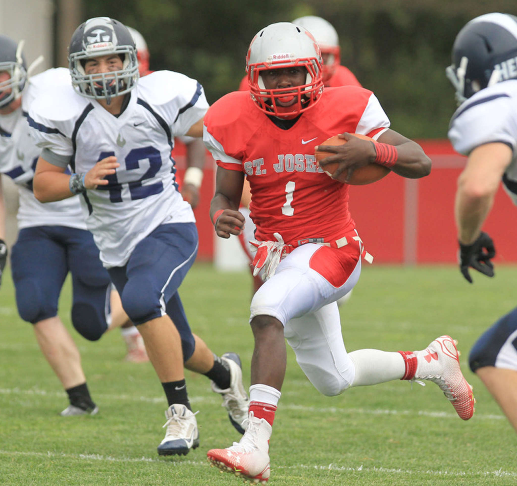 St. Joseph´s Salaam Horne picks up a long gain against St. Augustine in September. Many public schools are weary of losing to non-public powers, citing the recruitment advantage. Yet many public schools also have tuition students who are athletes.
