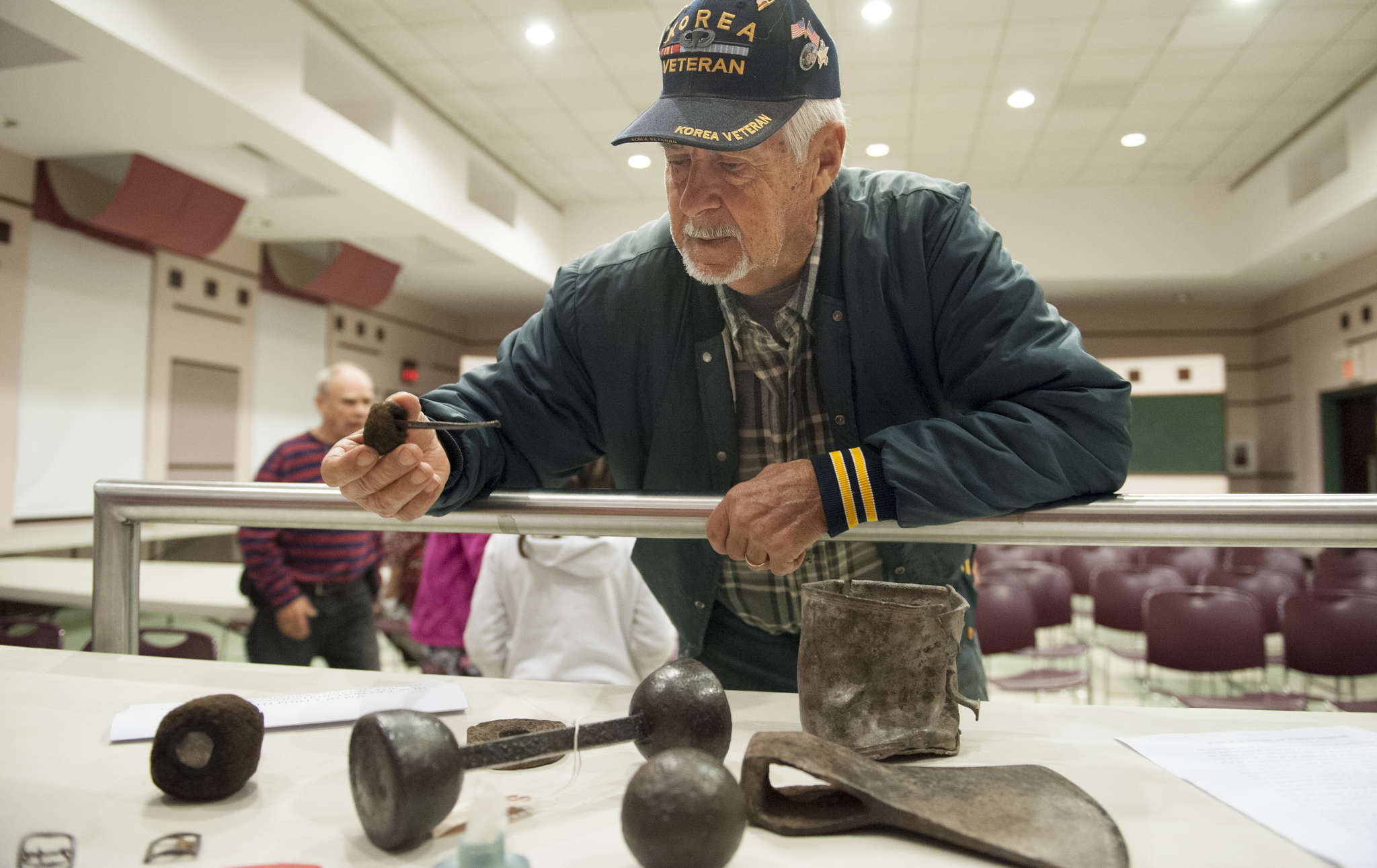 Henry Winzinger, of Jacksonville, N.J., examines a Colonial-era cannon cleaning rod found where I-95 was built in Philadelphia in the 1970s.