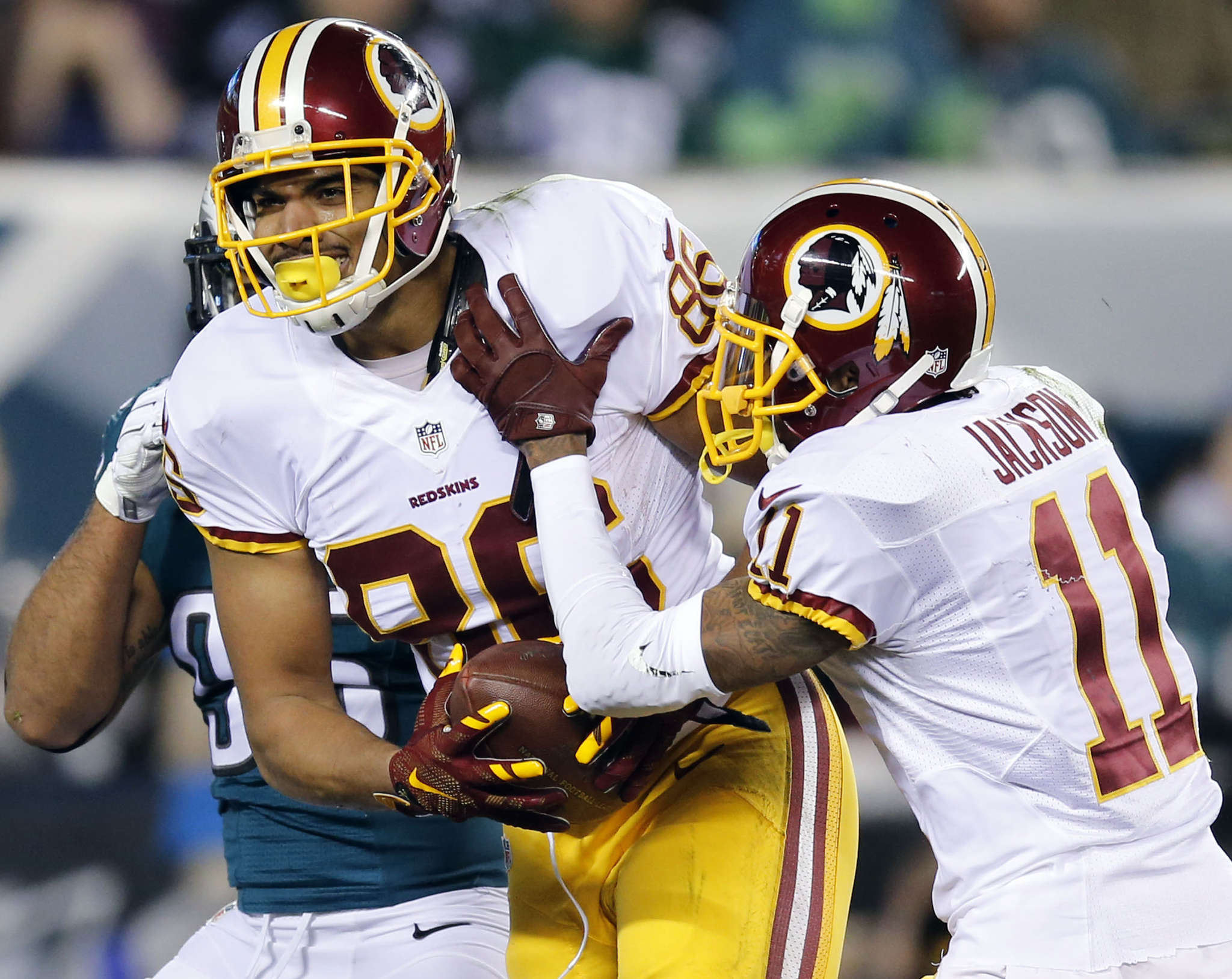 Jordan Reed celebrates the first of his two touchdowns with DeSean Jackson. YONG KIM / STAFF PHOTOGRAPHER