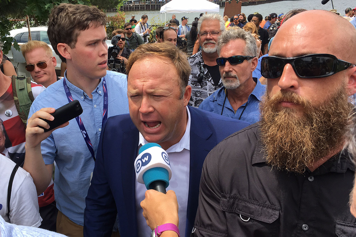 Alex Jones of infowars.com talks with reporters as he marches in a pro Donald Trump rally in Settlers Park, Cleveland, Ohio during the RNC on Monday July 19, 2016.